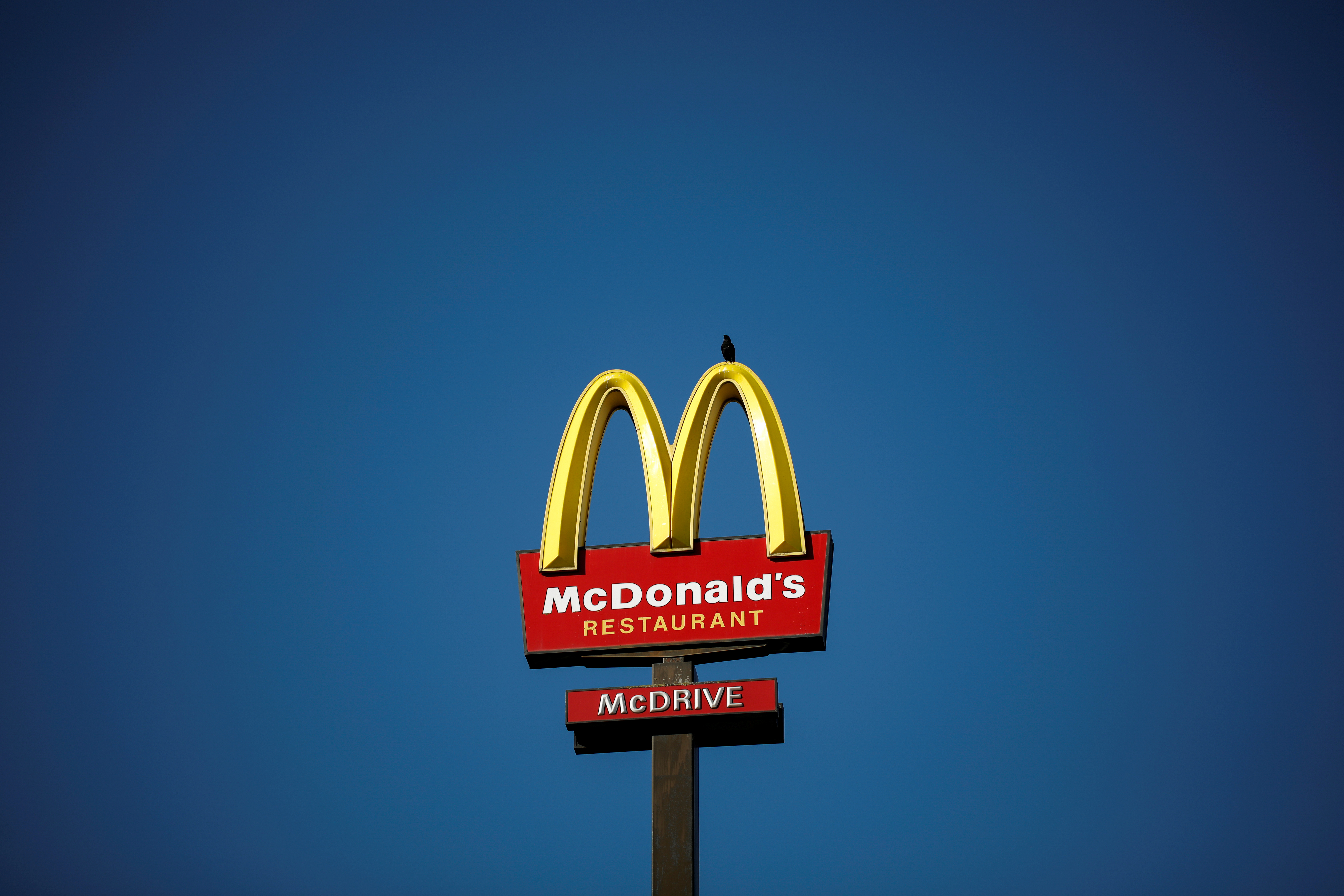 The McDonald's company logo stands on a sign outside a restaurant in Bretigny-sur-Orge, near Paris, France, July 30, 2020. REUTERS/Benoit Tessier/File Photo