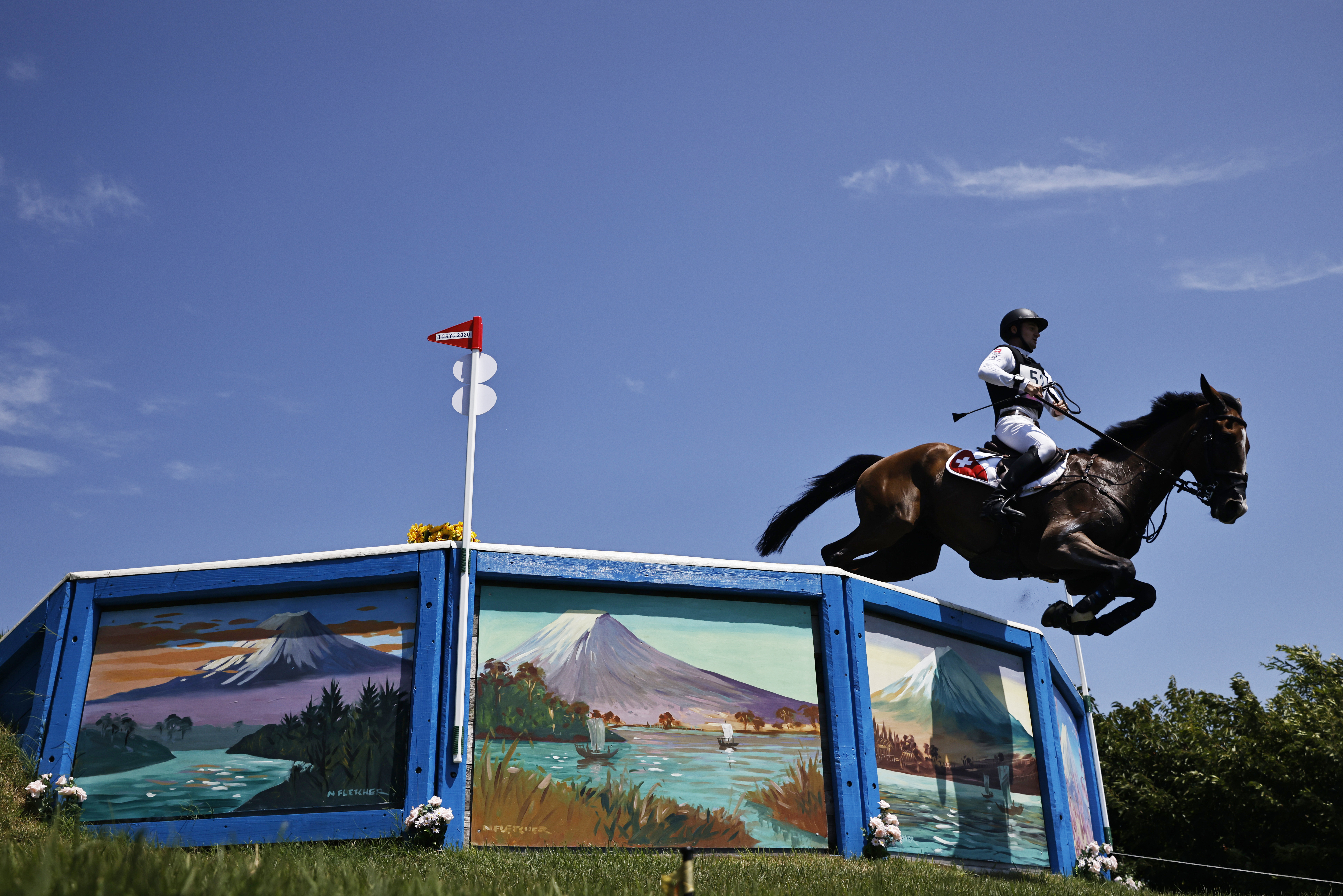 Tokyo 2020 Olympics - Equestrian - Eventing - Cross Country Individual - Final - Sea Forest XC Course - Tokyo, Japan - August 1, 2021. Robin Godel of Switzerland on his horse Jet Set compete REUTERS/Alkis Konstantinidis