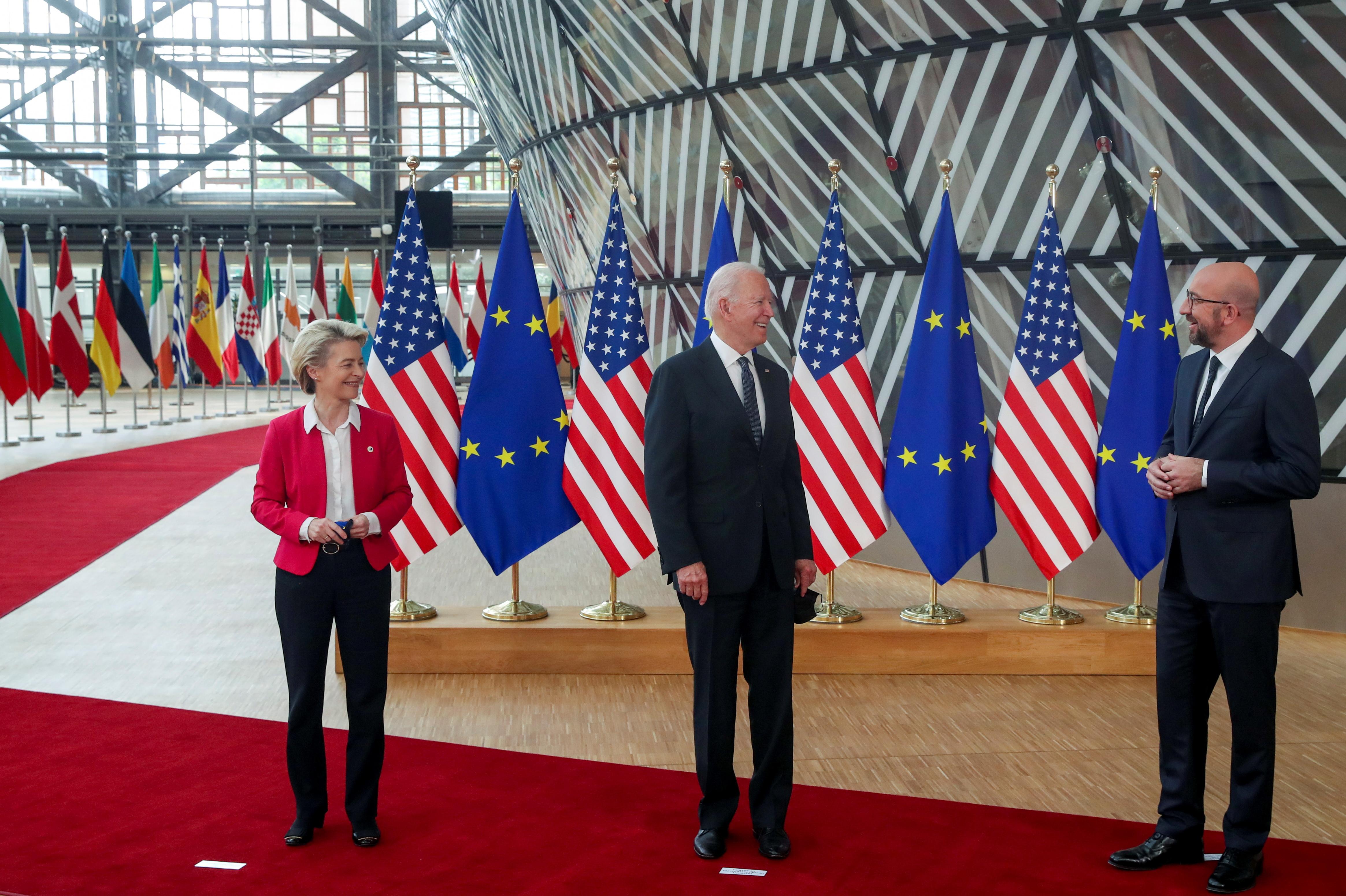 European Council President Charles Michel and European Commission President Ursula von der Leyen pose with U.S. President Joe Biden during the EU-US summit, in Brussels, Belgium June 15, 2021. REUTERS/Yves Herman