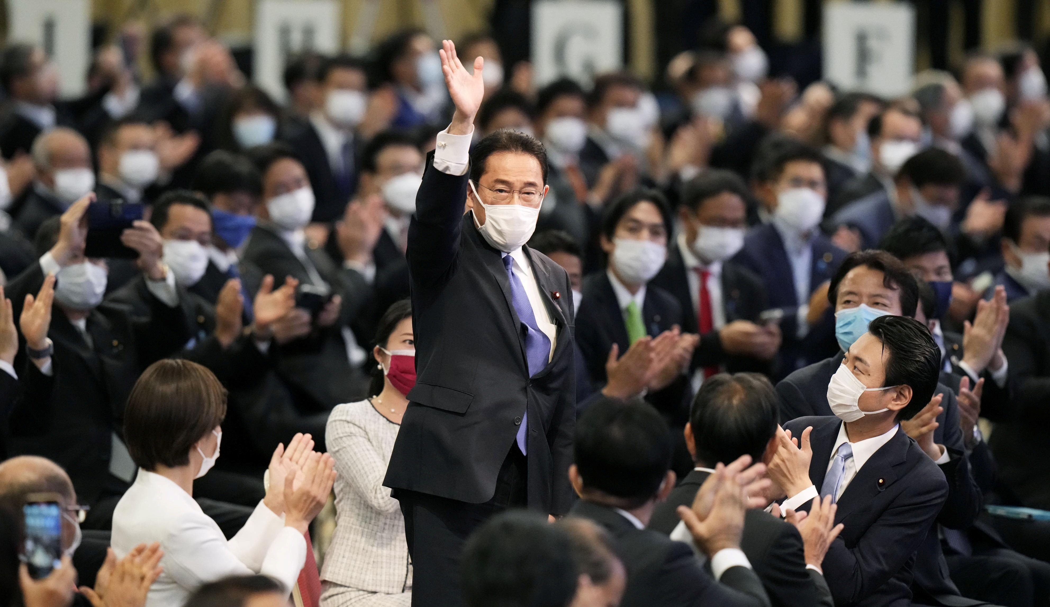 Former Japanese Foreign Minister Fumio Kishida gestures as he is elected as new head of the ruling party in the Liberal Democratic Party's (LDP) leadership vote in Tokyo, Japan September 29, 2021. Kyodo/via REUTERS