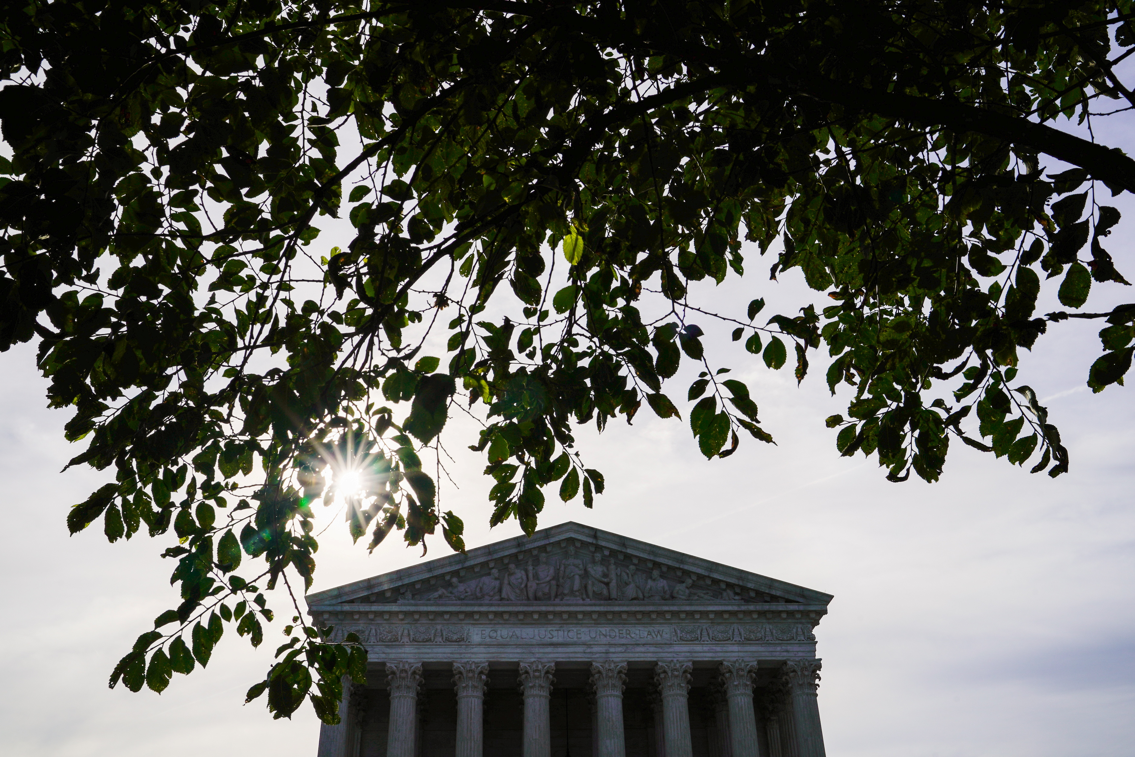 The sun rises behind the U.S. Supreme Court in Washington, U.S., June 1, 2021. REUTERS/Erin Scott