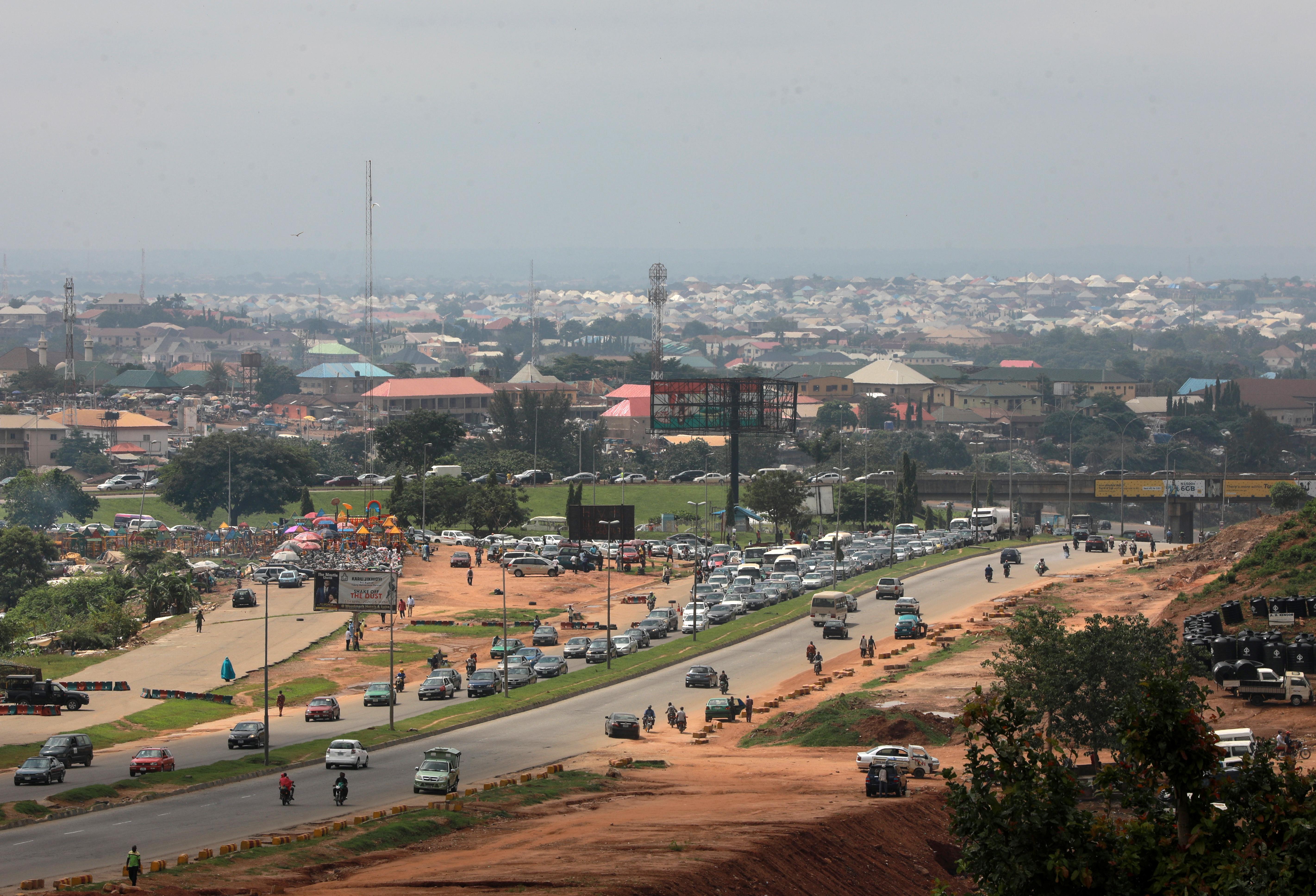 Cars drive along a street in Abuja, Nigeria June 25, 2020. REUTERS/Afolabi Sotunde