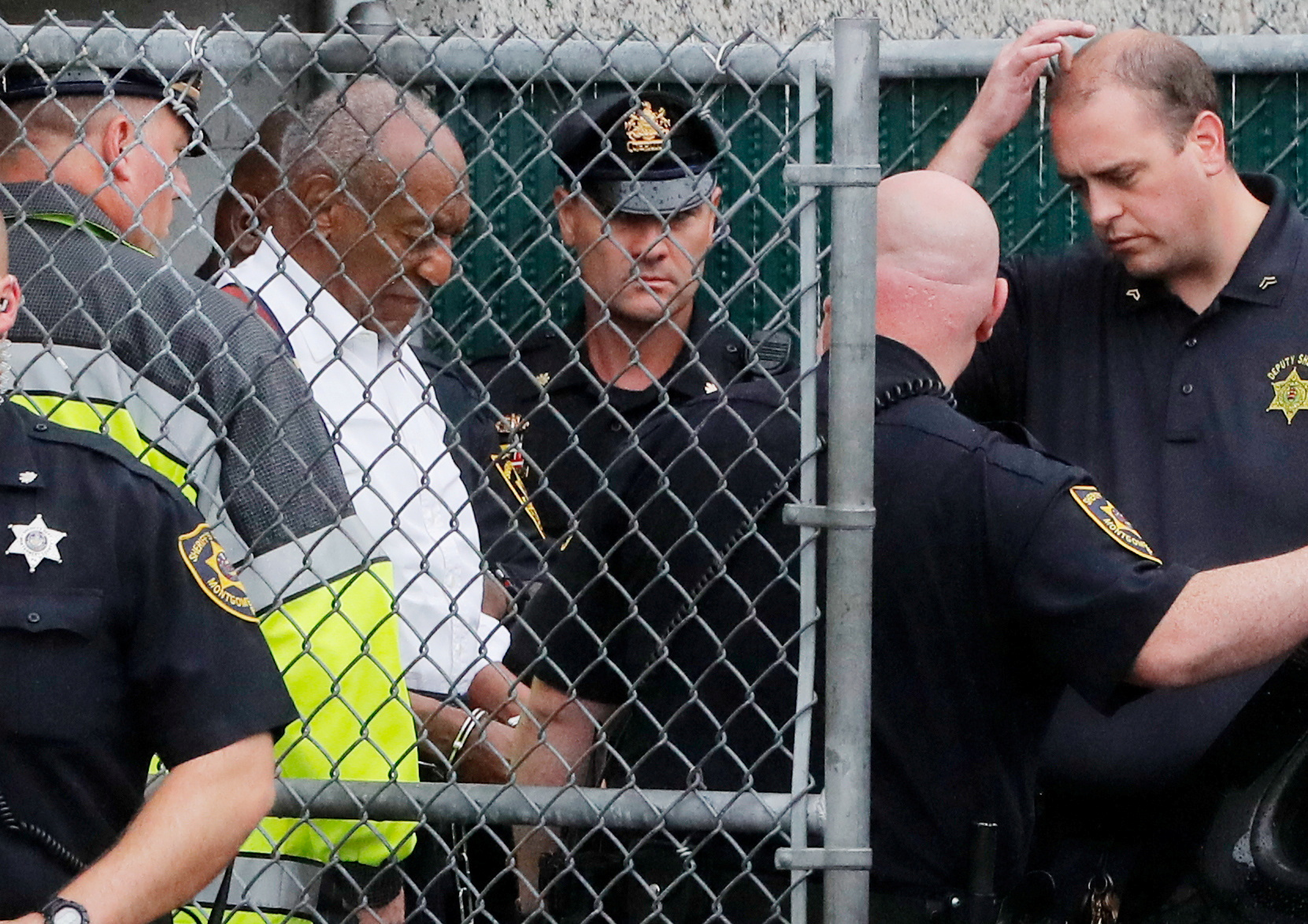 Actor and comedian Bill Cosby leaves the Montgomery County Courthouse in handcuffs after sentencing in his sexual assault trial in Norristown, Pennsylvania, U.S., September 25, 2018. REUTERS/Brendan McDermid