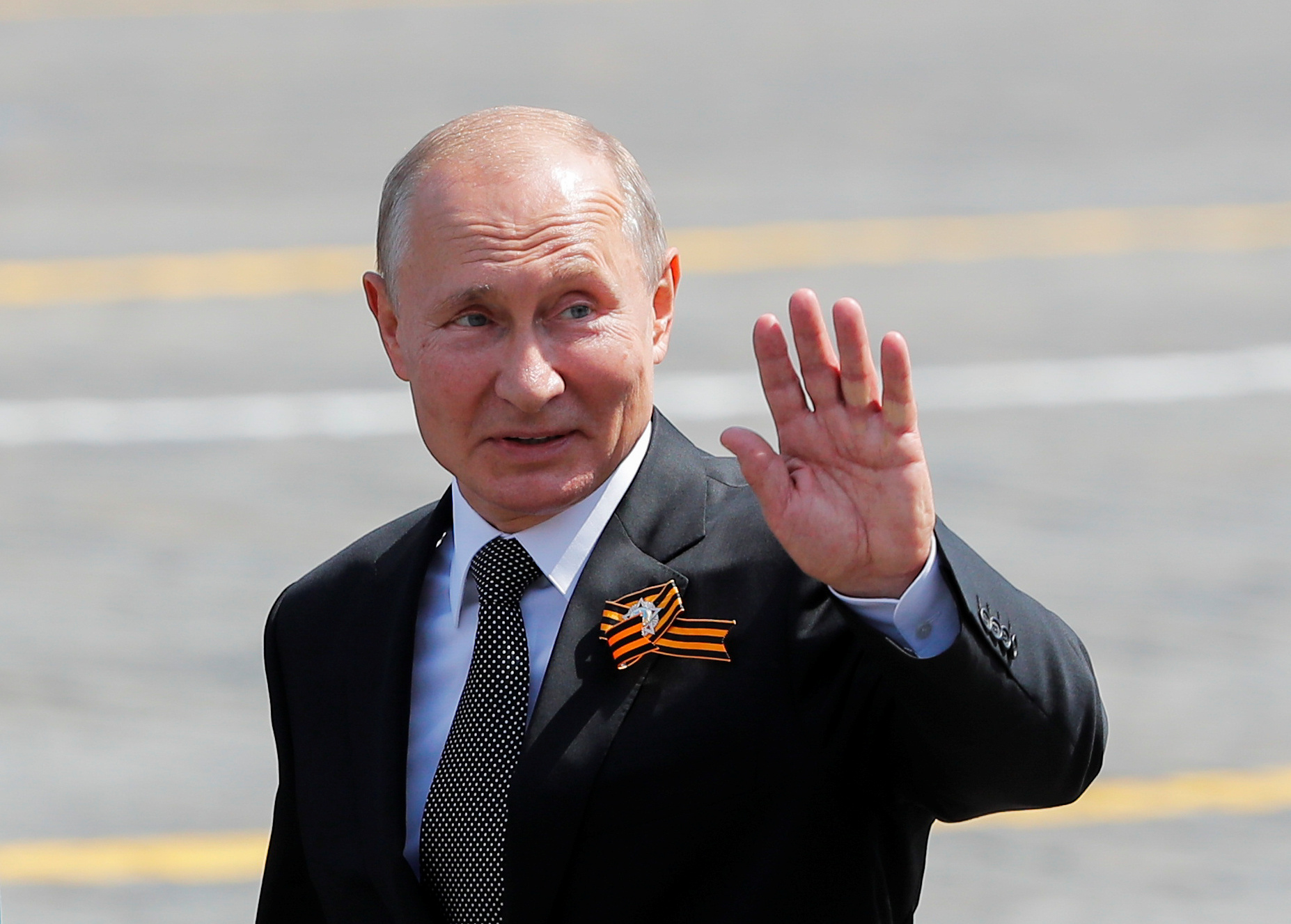 Russia's President Vladimir Putin waves as he leaves after the Victory Day Parade in Red Square in Moscow, Russia June 24, 2020. REUTERS/Maxim Shemetov
