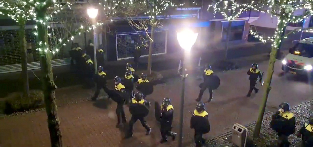 Police officers and vehicles arrive to disperse people from the site of one of the coronavirus disease (COVID-19) curfew protests in Geleen, Netherlands January 25, 2021, in this still image from video obtained from social media. Evert Bopp via REUTERS