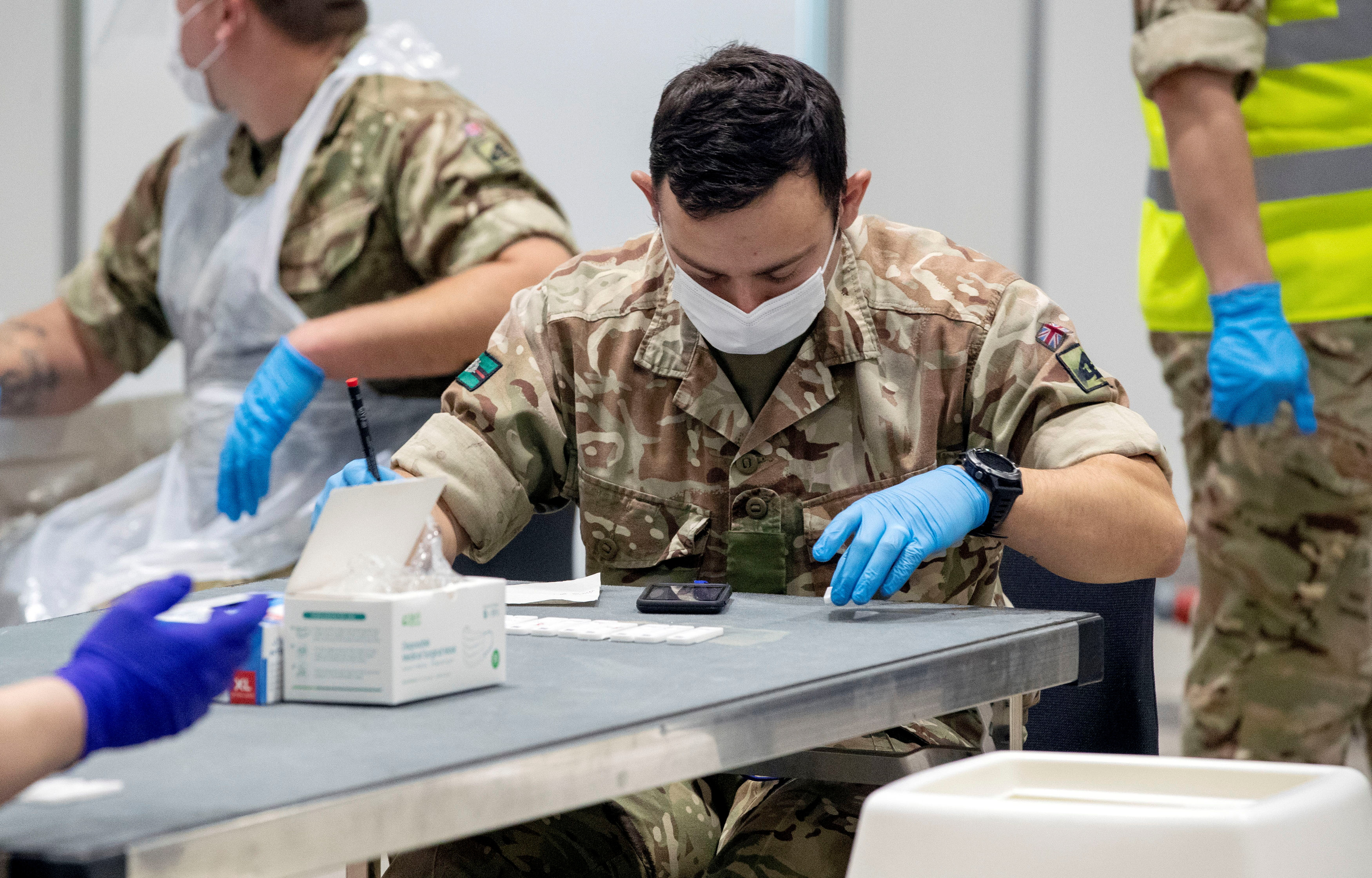 Soldiers work at The Exhibition Centre, which has been set up as a testing centre as part of the mass coronavirus disease (COVID-19) testing, in Liverpool, Britain, November 6, 2020. Peter Byrne/PA Wire/Pool via REUTERS/File Photo
