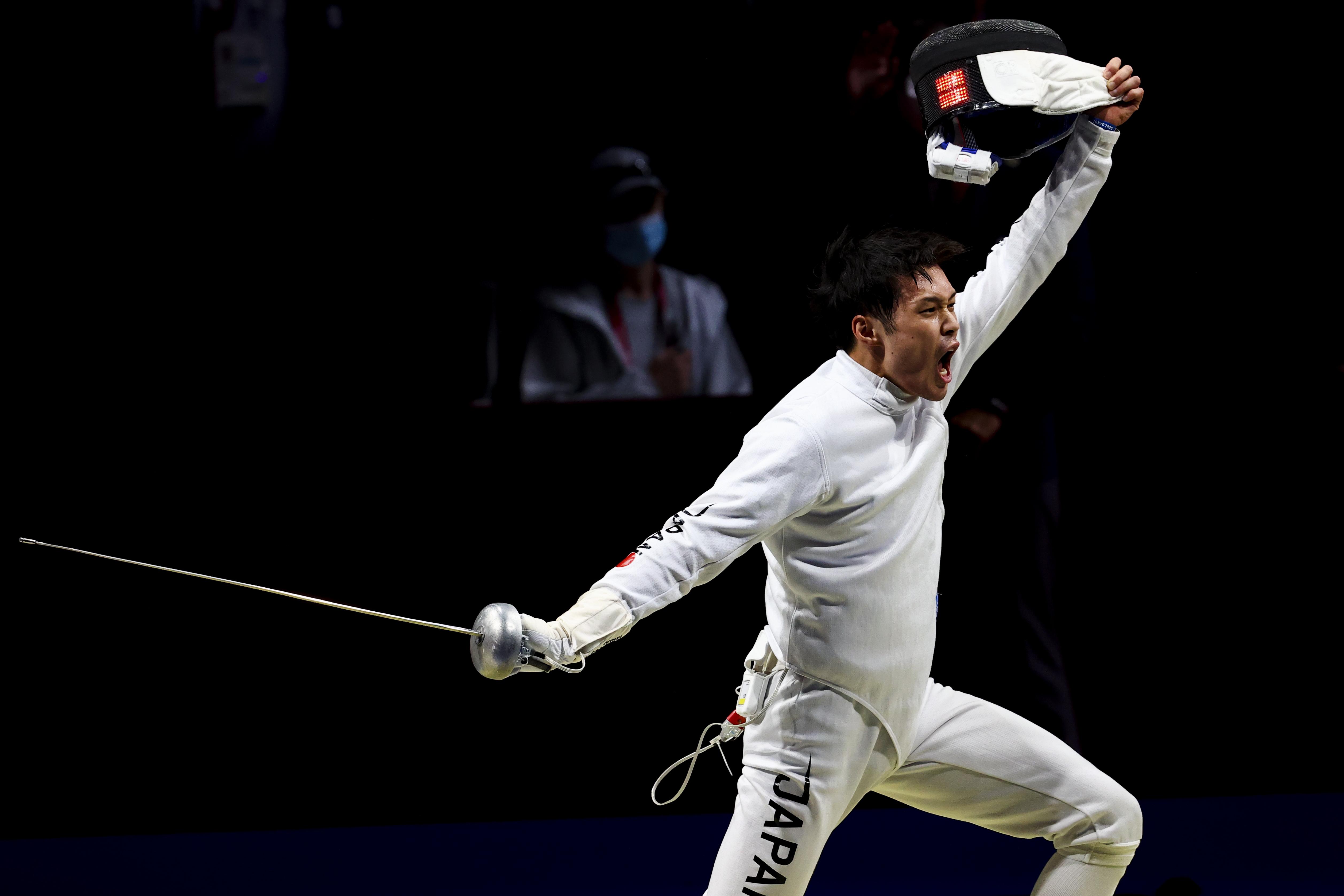 Tokyo 2020 Olympics - Fencing - Men's Individual Epee - Last 32 - Makuhari Messe Hall B - Chiba, Japan - July 25, 2021. Masaru Yamada of Japan celebrates after competing REUTERS/Maxim Shemetov