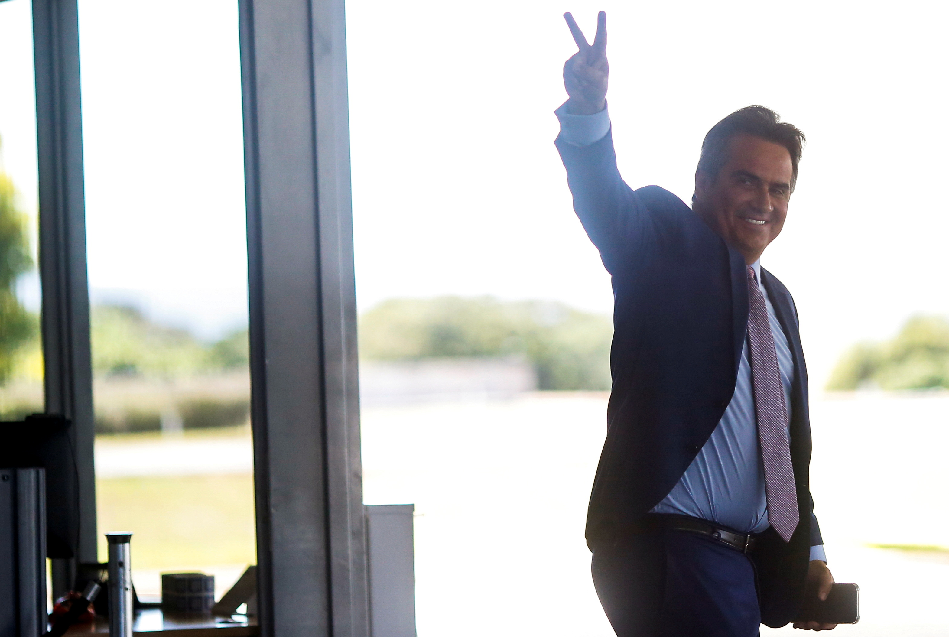 Brazilian Senator Ciro Nogueira gestures after meeting with Brazil's President Jair Bolsonaro (not pictured) at the Planalto Palace in Brasilia, Brazil July 27, 2021. REUTERS/Adriano Machado/File Photo