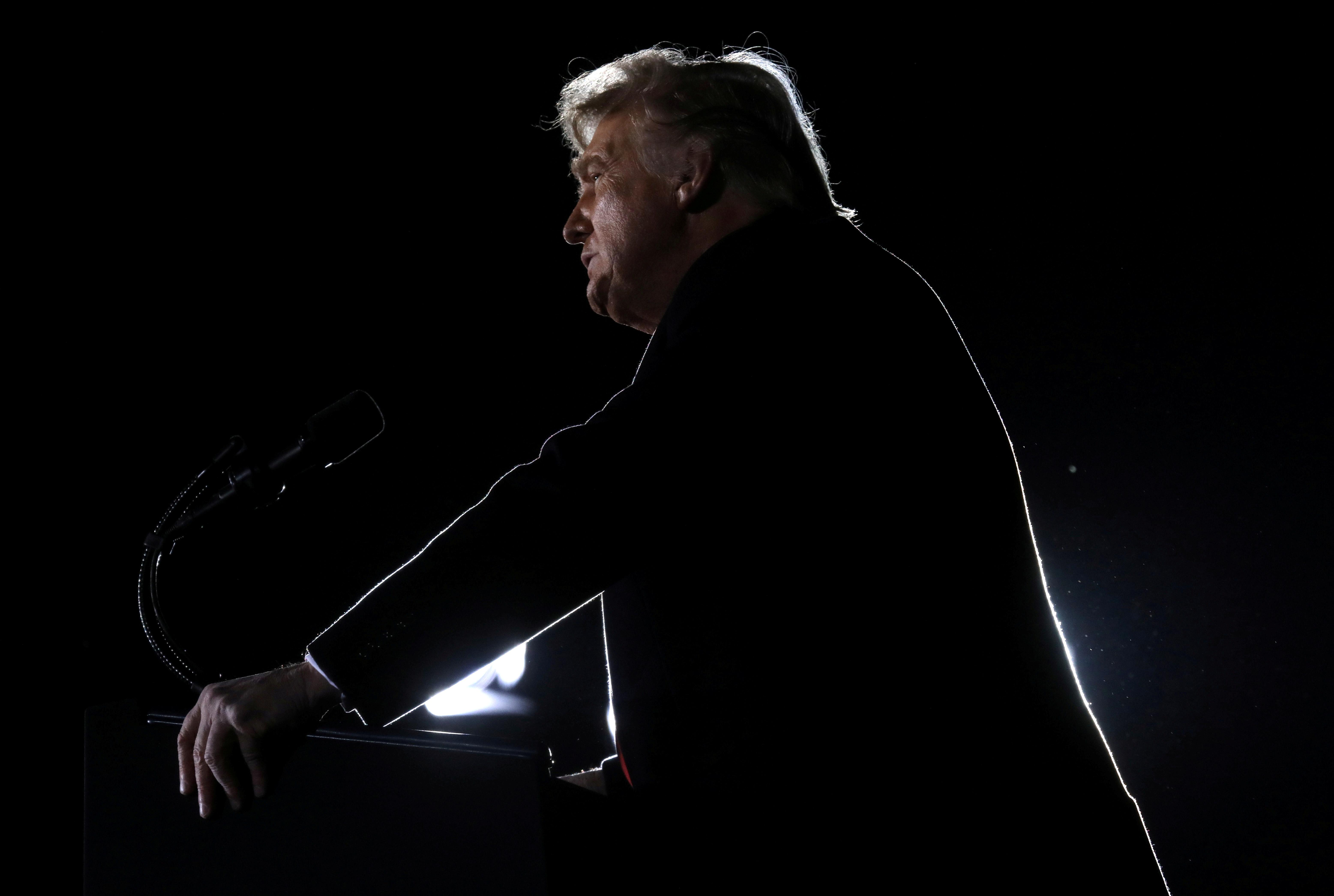 U.S. President Donald Trump addresses a campaign rally in Dalton, Georgia, U.S., on the eve of the run-off election to decide both of Georgia