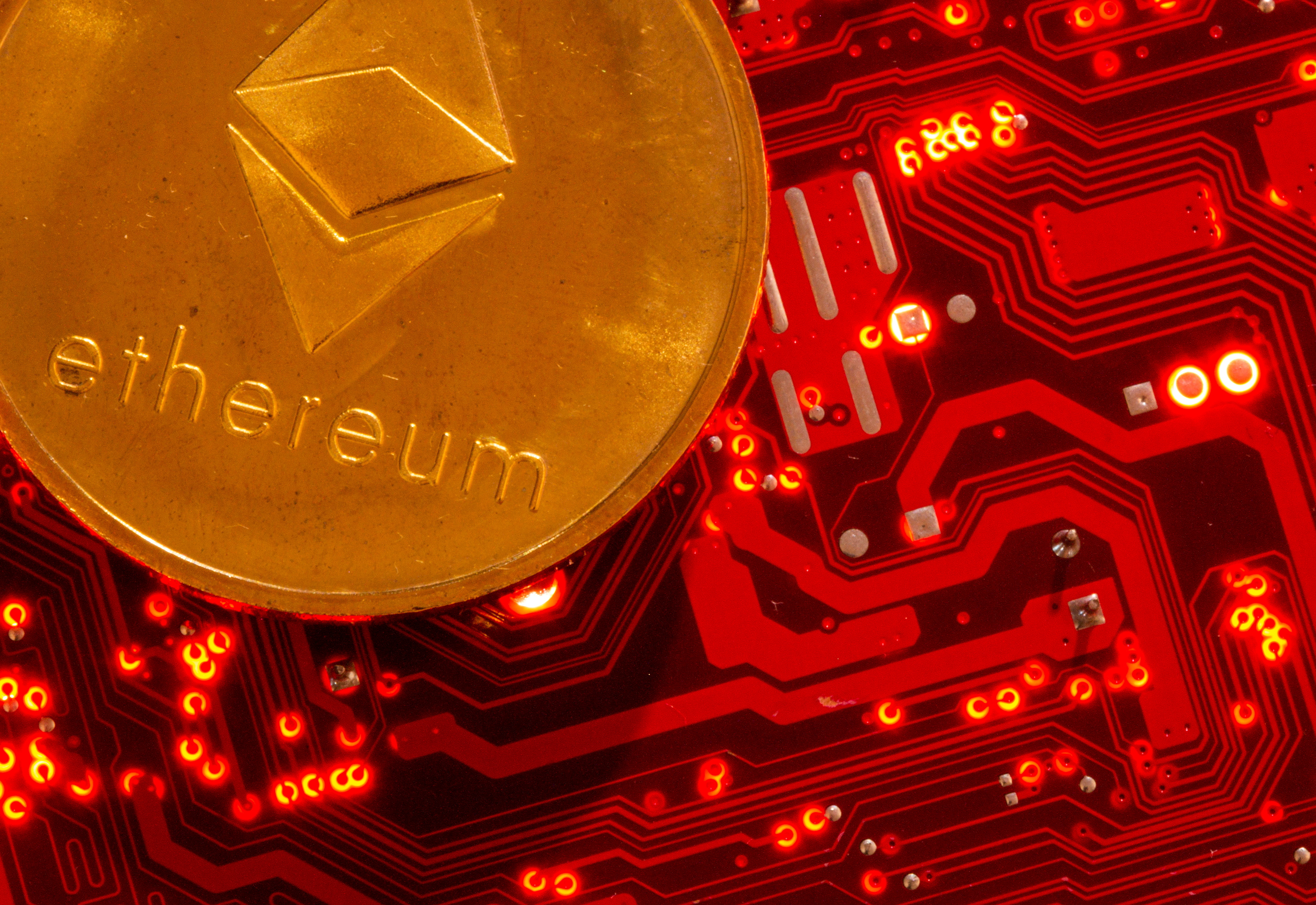 Representation of cryptocurrency Ethereum is placed on PC motherboard in this illustration taken, June 29, 2021. REUTERS/Dado Ruvic/Illustration/File Photo