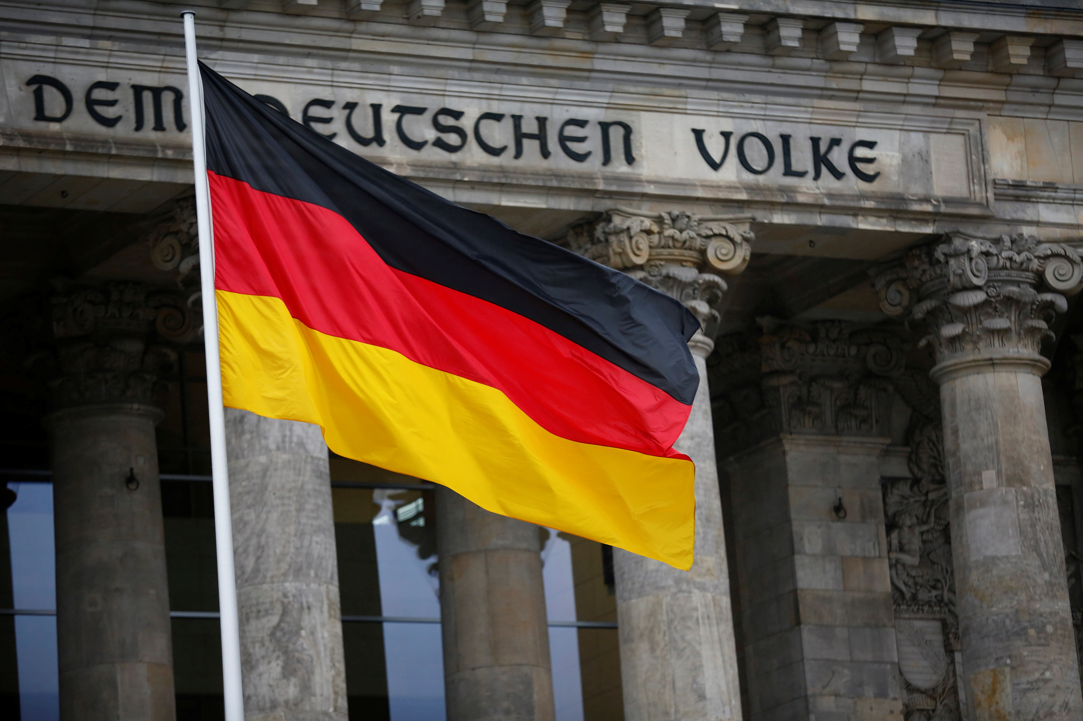 The German flag is seen outside Germany's Bundestag, the lower house of parliament. in Berlin, Germany, March 14, 2018. REUTERS/Hannibal Hanschke