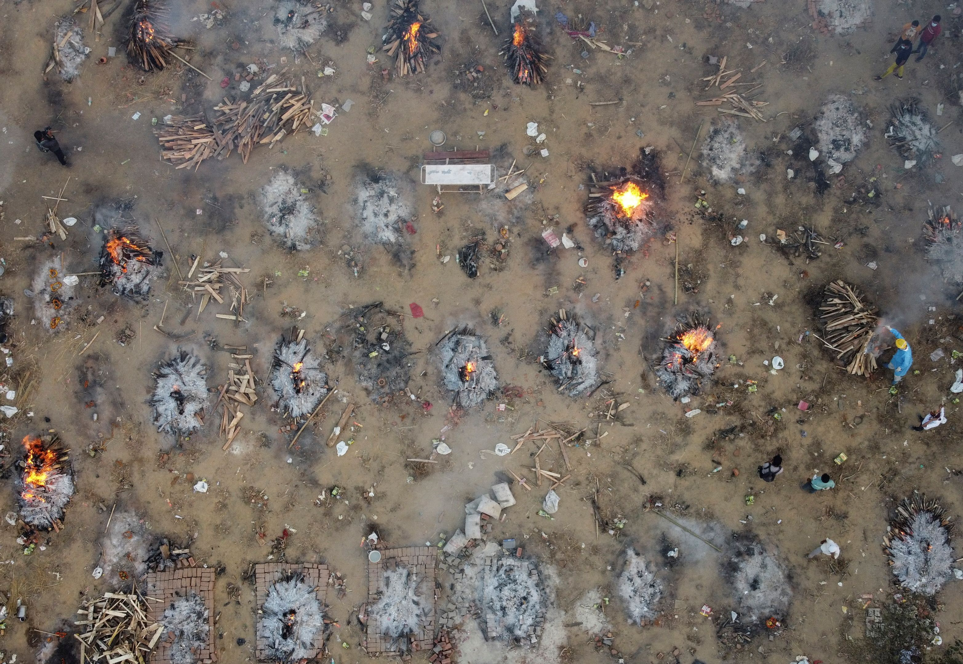Mass cremations begin as India's capital faces deluge of COVID-19 deaths |  Reuters
