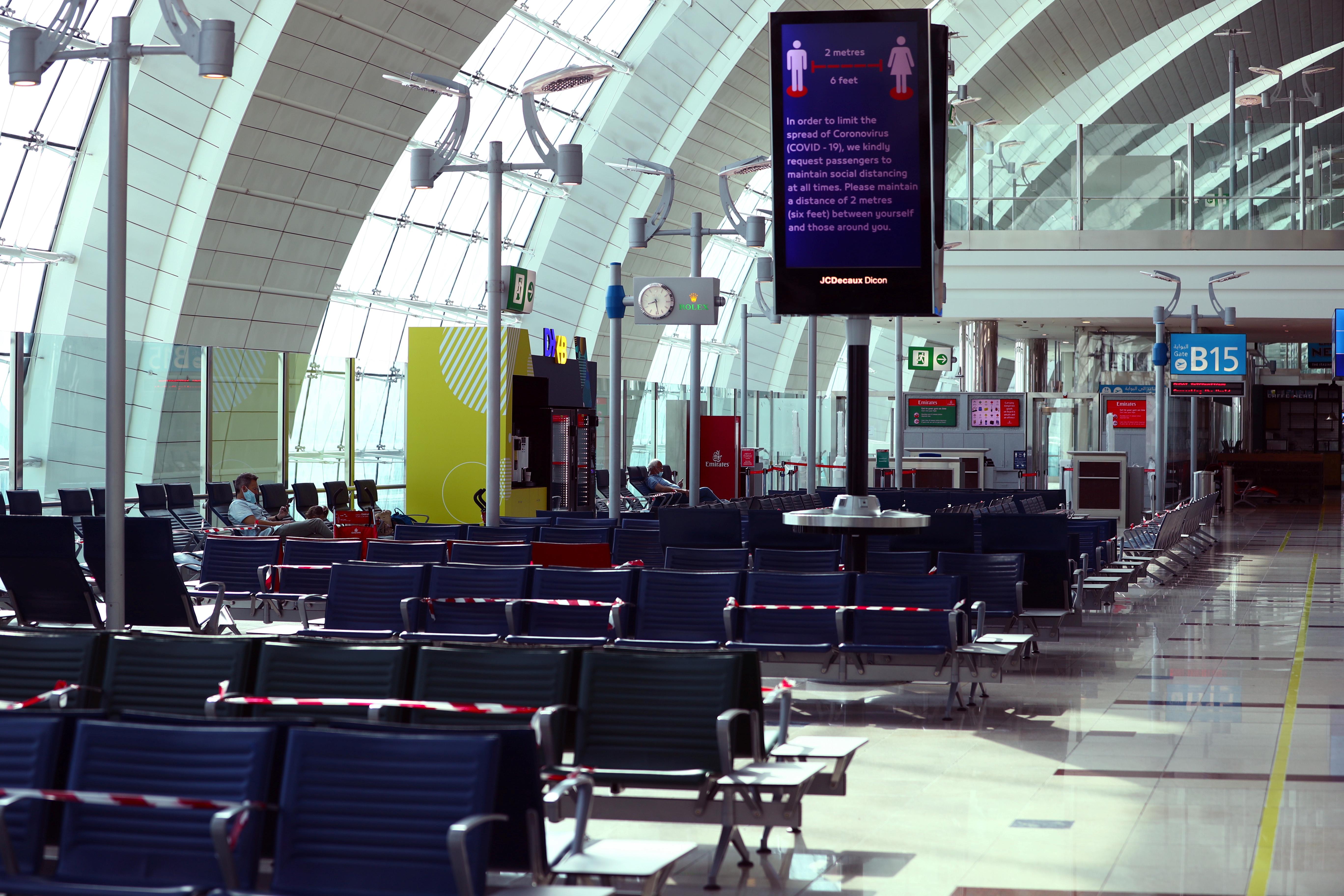 Passengers wait before boarding at Dubai International Airport, as Emirates airline resumed limited outbound passenger flights amid outbreak of the coronavirus disease (COVID-19) in Dubai, UAE April 27, 2020. REUTERS/Ahmed Jadallah