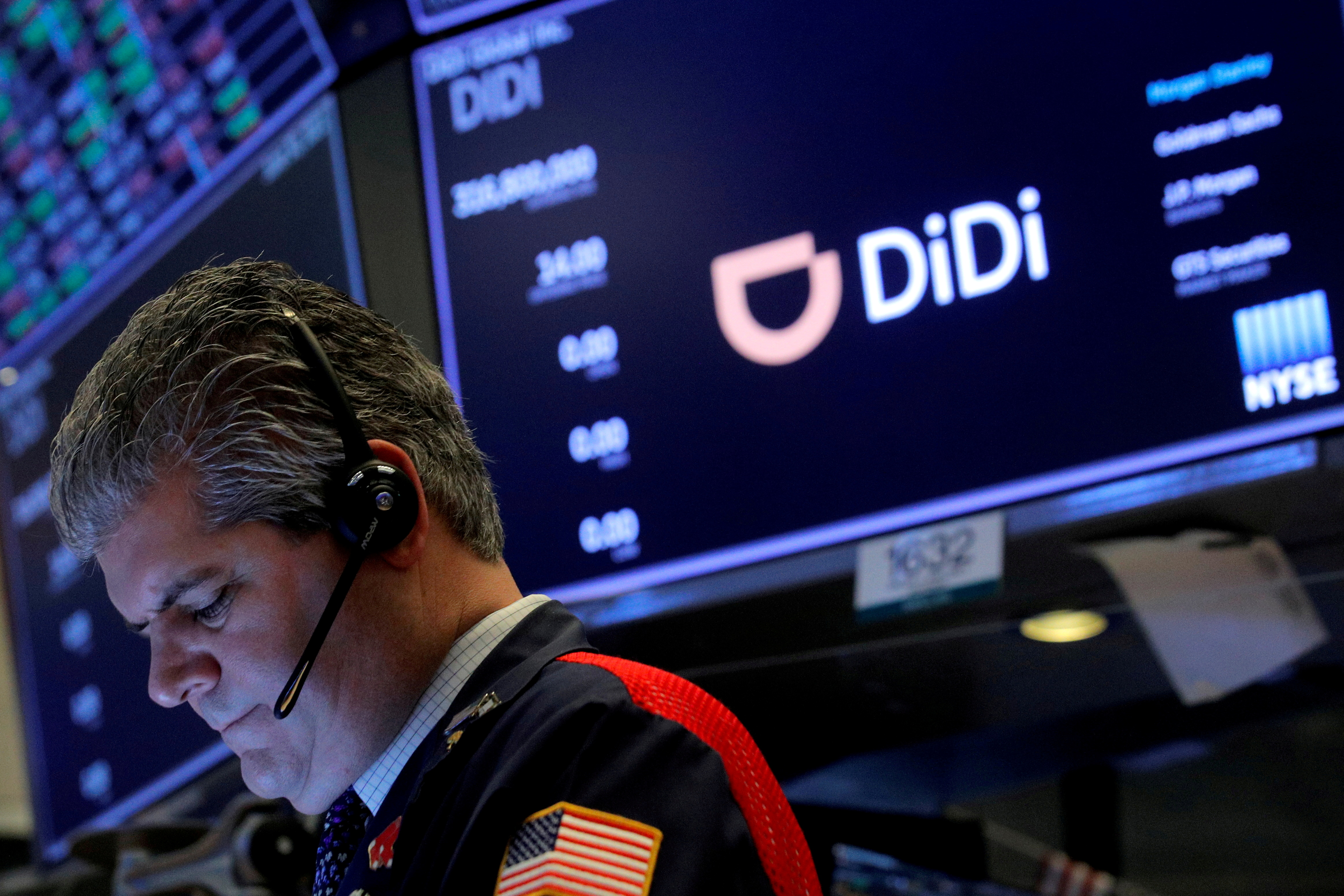 A trader works during the IPO for Chinese ride-hailing company Didi Global Inc on the New York Stock Exchange (NYSE) floor in New York City, U.S., June 30, 2021.  REUTERS/Brendan McDermid/File Photo