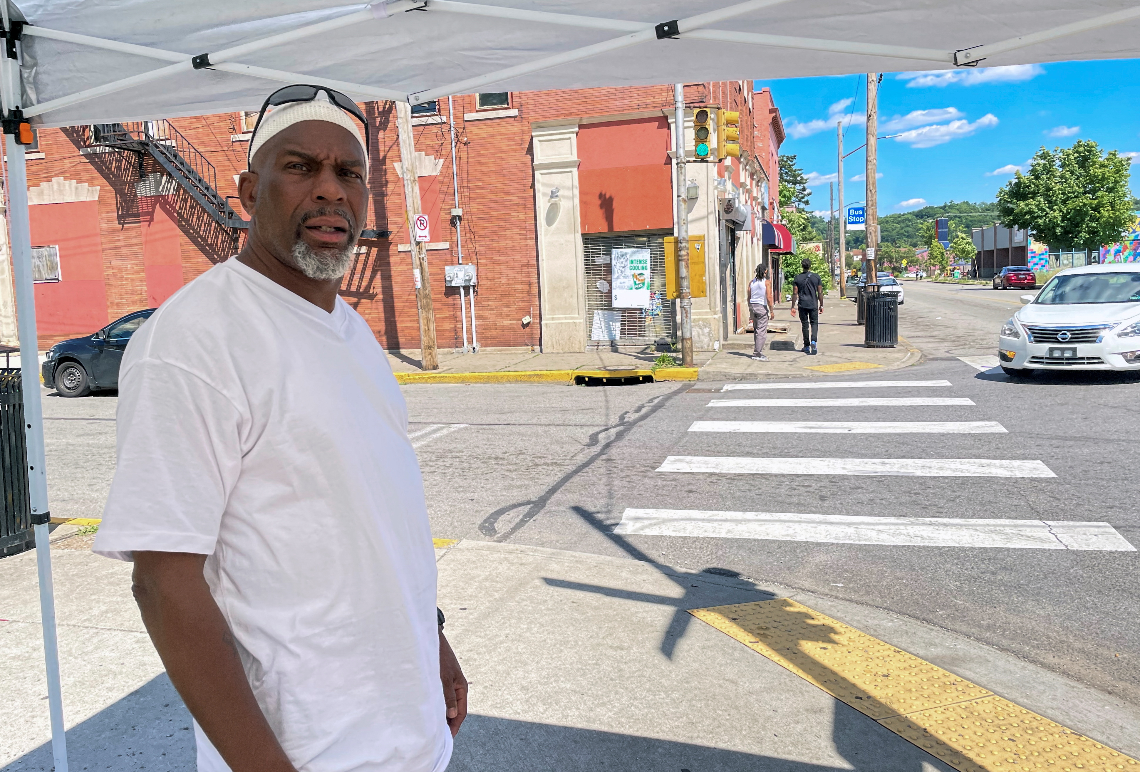 Street vendor Akeem Everett stands near Frankstown Avenue in Pittsburgh, Pennsylvania, U.S. June 23, 2021. REUTERS/Andy Sullivan