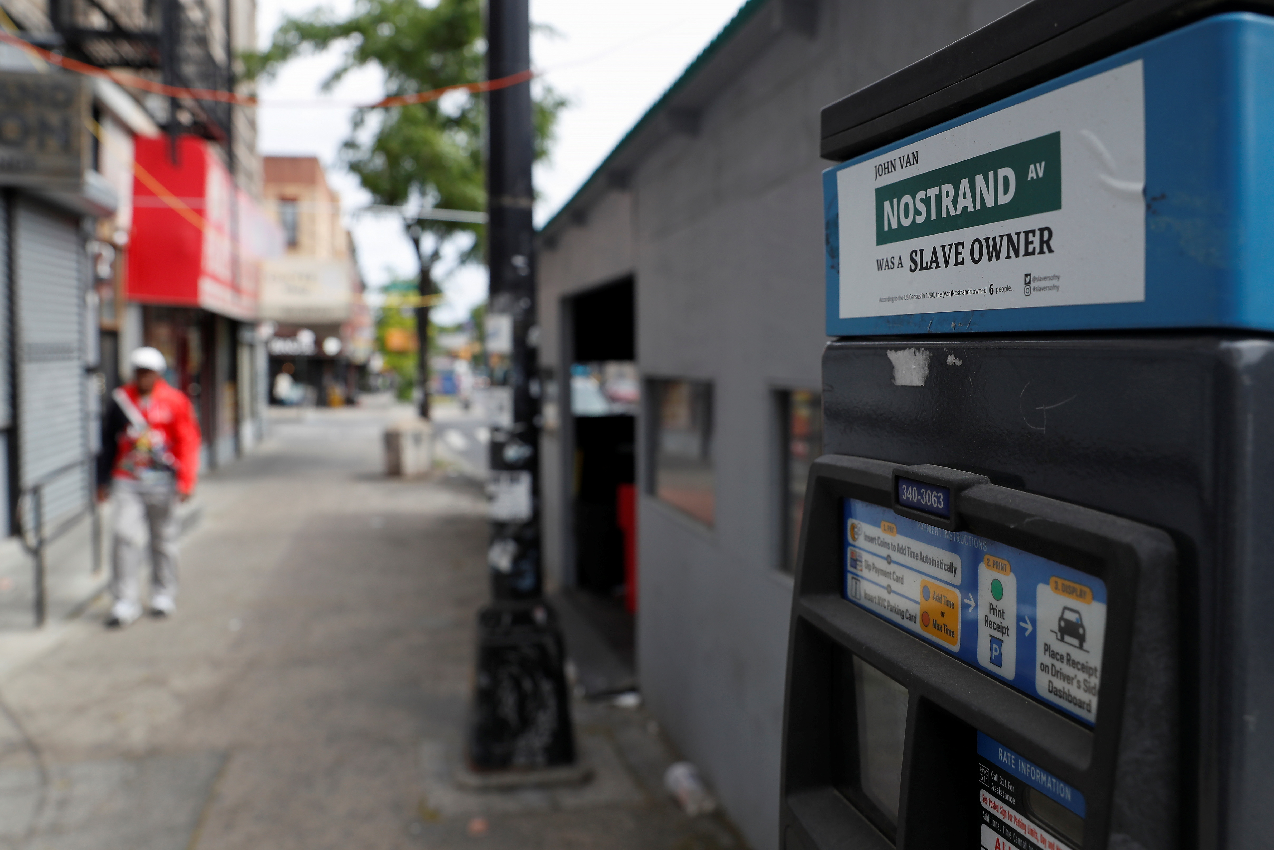 A 'Slavers of New York' campaign sticker is posted on a parking pay station in the Bedford-Stuyvesant section of the Brooklyn borough of New York City, U.S., May 24, 2021. Picture taken May 24, 2021. REUTERS/Shannon Stapleton