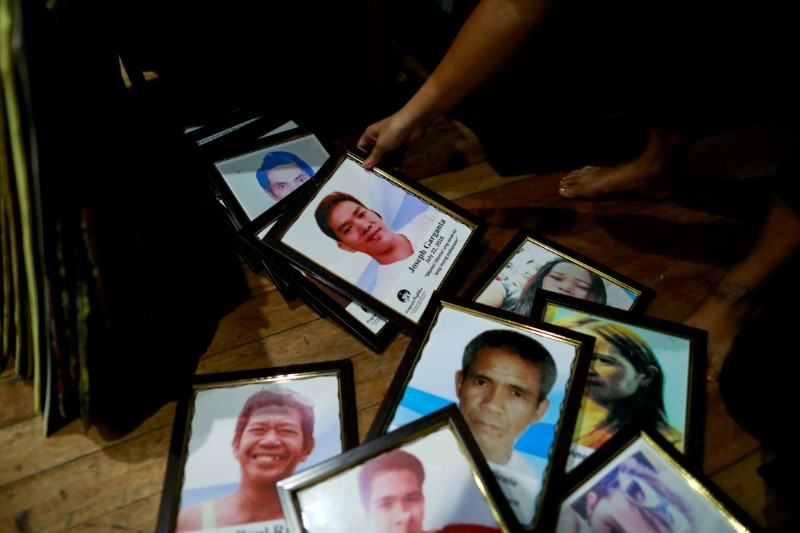 Framed portraits of Philippines' drug war victims are prepared for the theatre performance of grieving families on their journey of loss and healing in a Catholic school in Makati City, Philippines, March 4, 2020. REUTERS/Eloisa Lopez