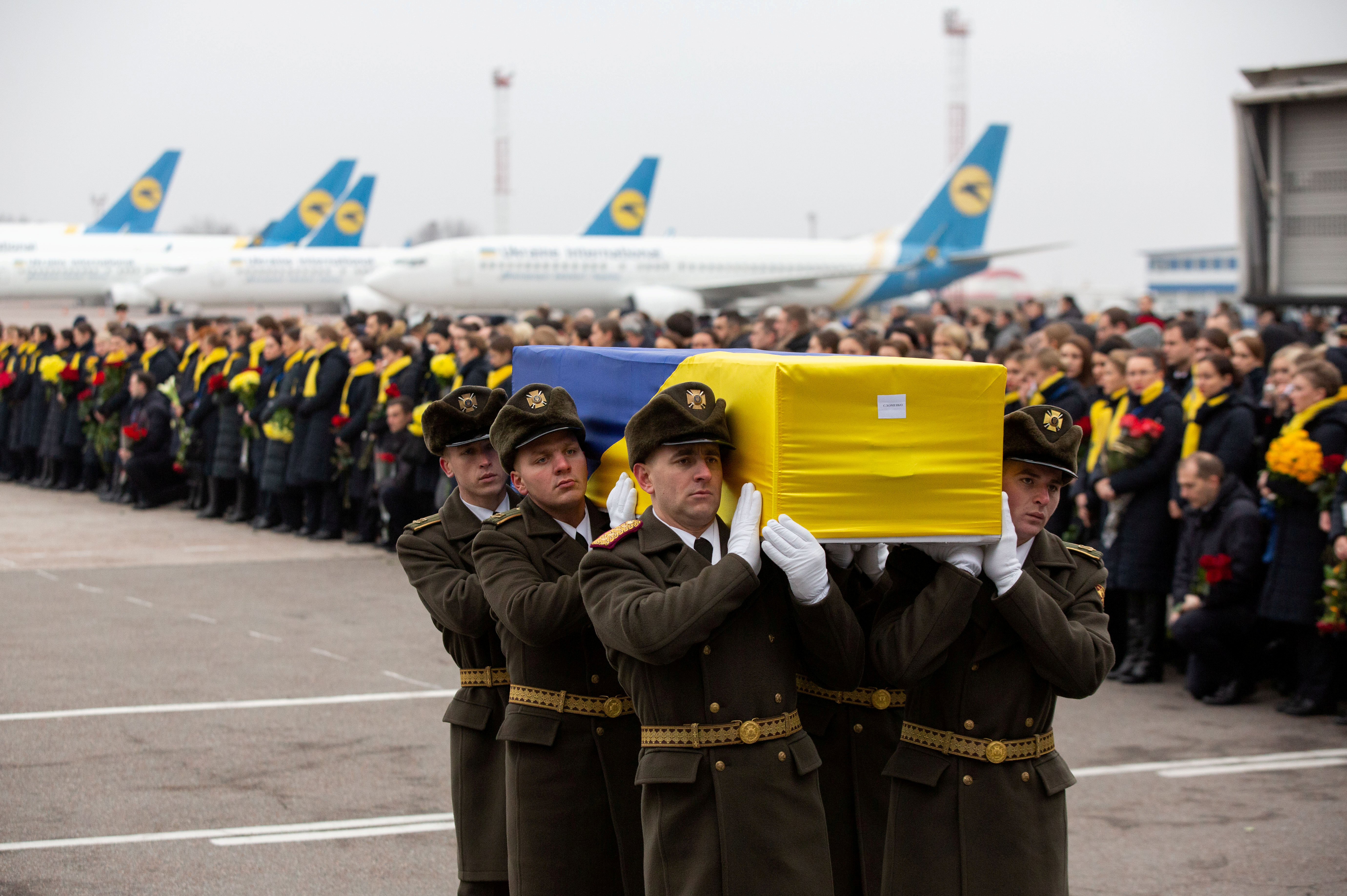 Soldiers carry a coffin containing the remains of one of the eleven Ukrainian victims of the Ukraine International Airlines flight 752 plane disaster, at Boryspil International Airport, outside Kiev, Ukraine, January 19, 2020. Ukrainian Presidential Press Service/Handout via REUTERS