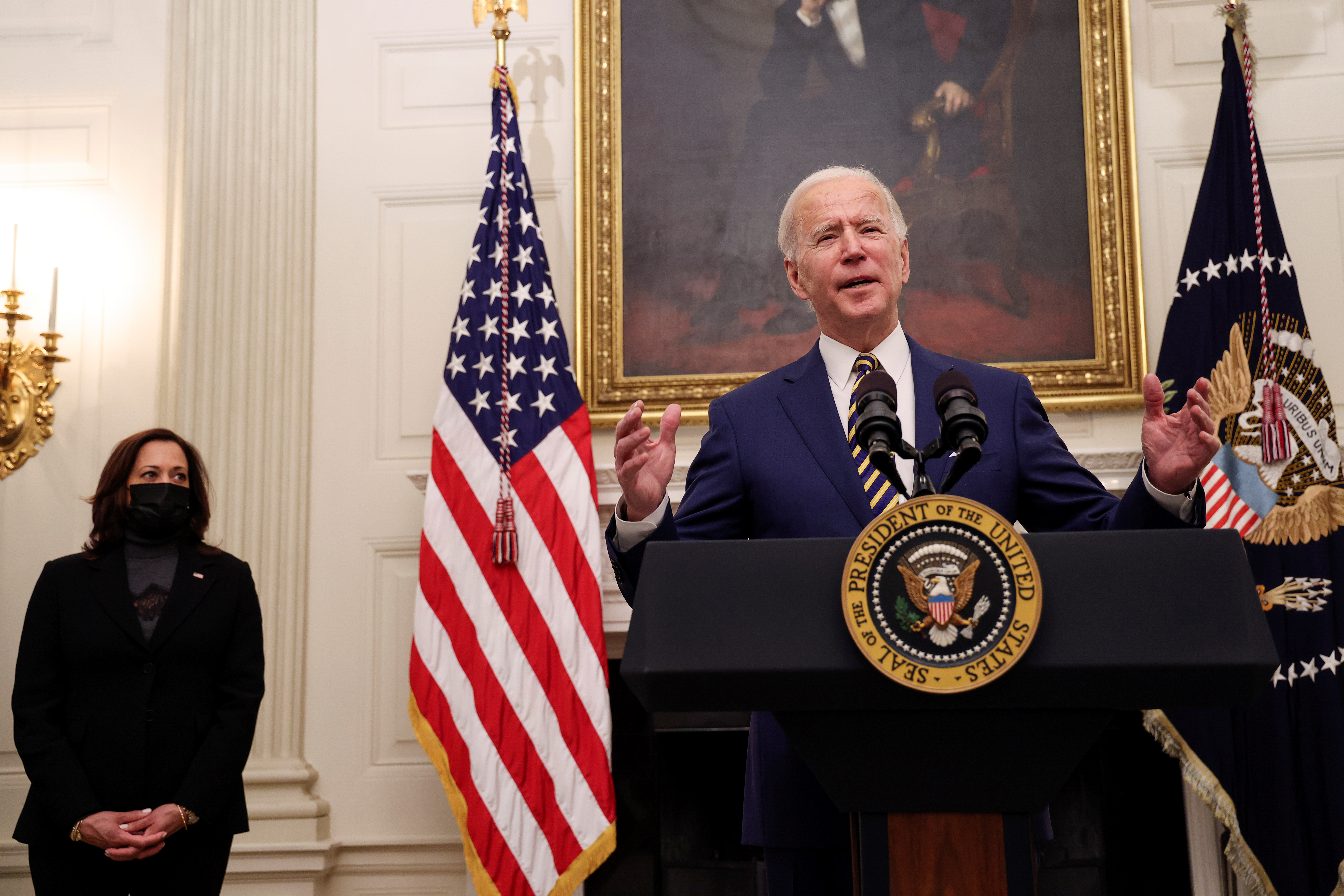 U.S. President Joe Biden speaks about his administration's plans to respond to the economic crisis as Vice President Kamala Harris listens during a coronavirus disease (COVID-19) response event in the State Dining Room at the White House in Washington, U.S., January 22, 2021. REUTERS/Jonathan Ernst