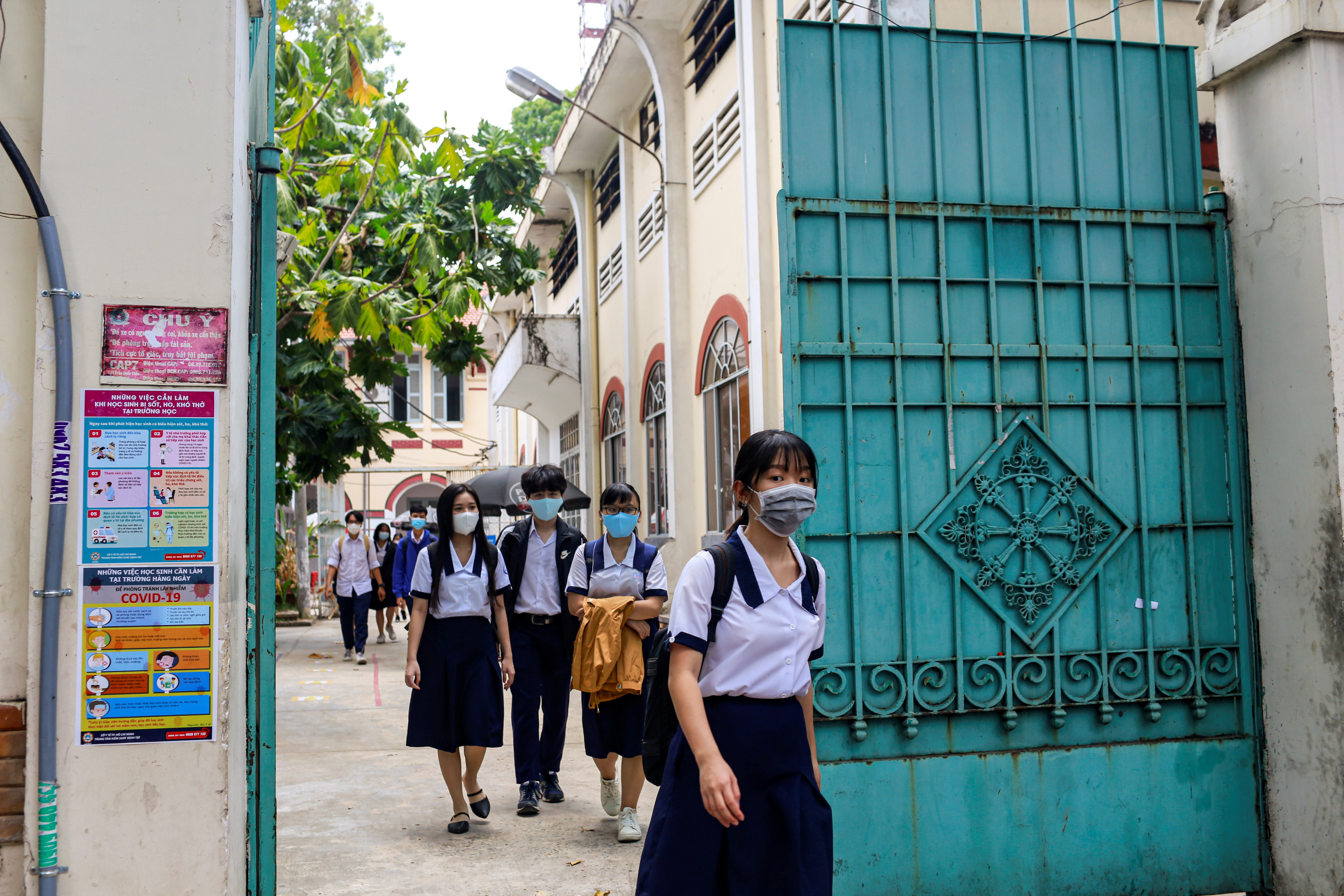 High school students leave their first day of class after the government eased nationwide lockdown during the coronavirus disease (COVID-19) outbreak in Ho Chi Minh, Vietnam May 5, 2020. REUTERS/Yen Duong