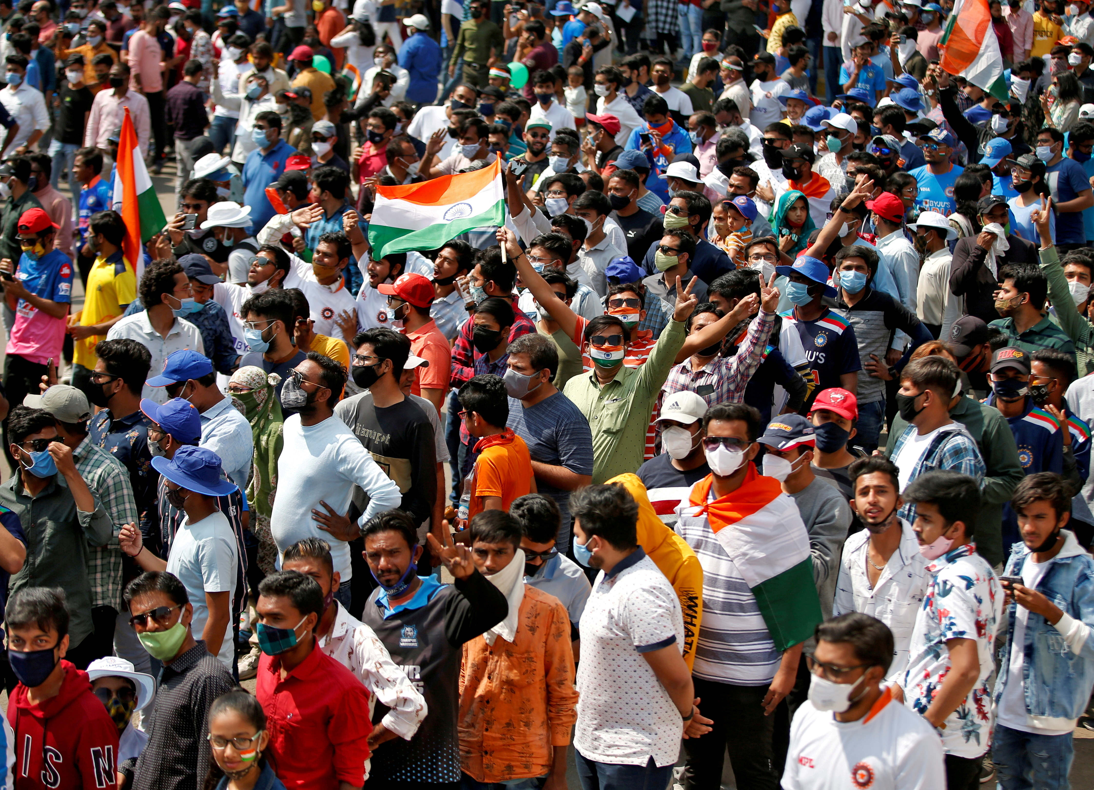 Fans react as they wait to enter the Narendra Modi Stadium before the start of the third test match between India and England in Ahmedabad, India, February 24, 2021. REUTERS/Amit Dave/File Photo