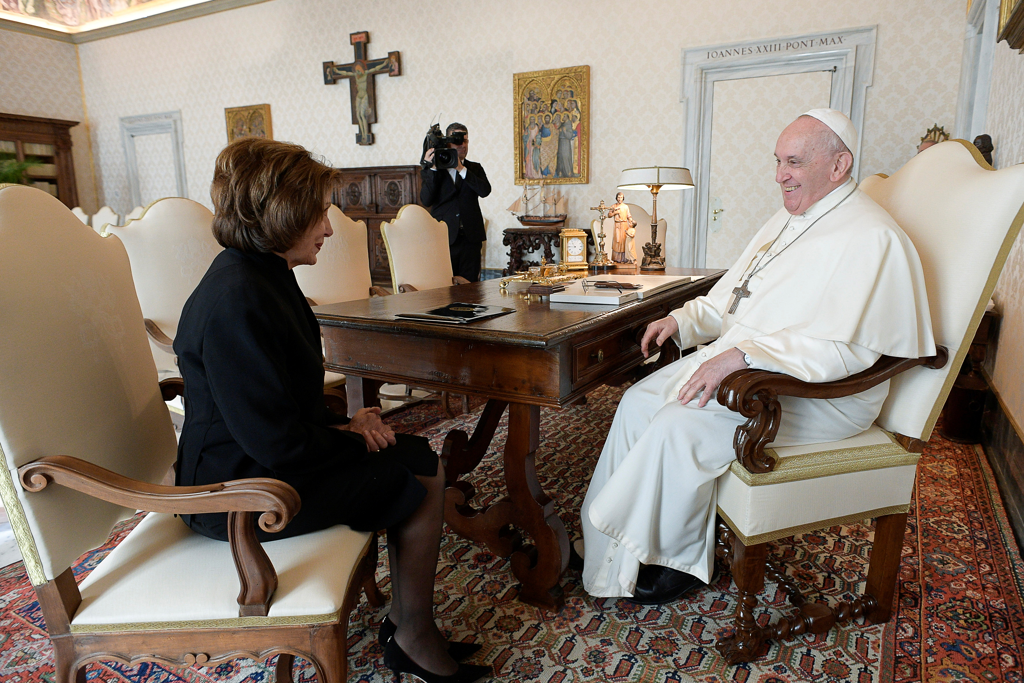 Pope Francis speaks with U.S. Speaker of the House Nancy Pelosi as they meet at the Vatican, October 9, 2021.  Vatican Media/Handout via REUTERS