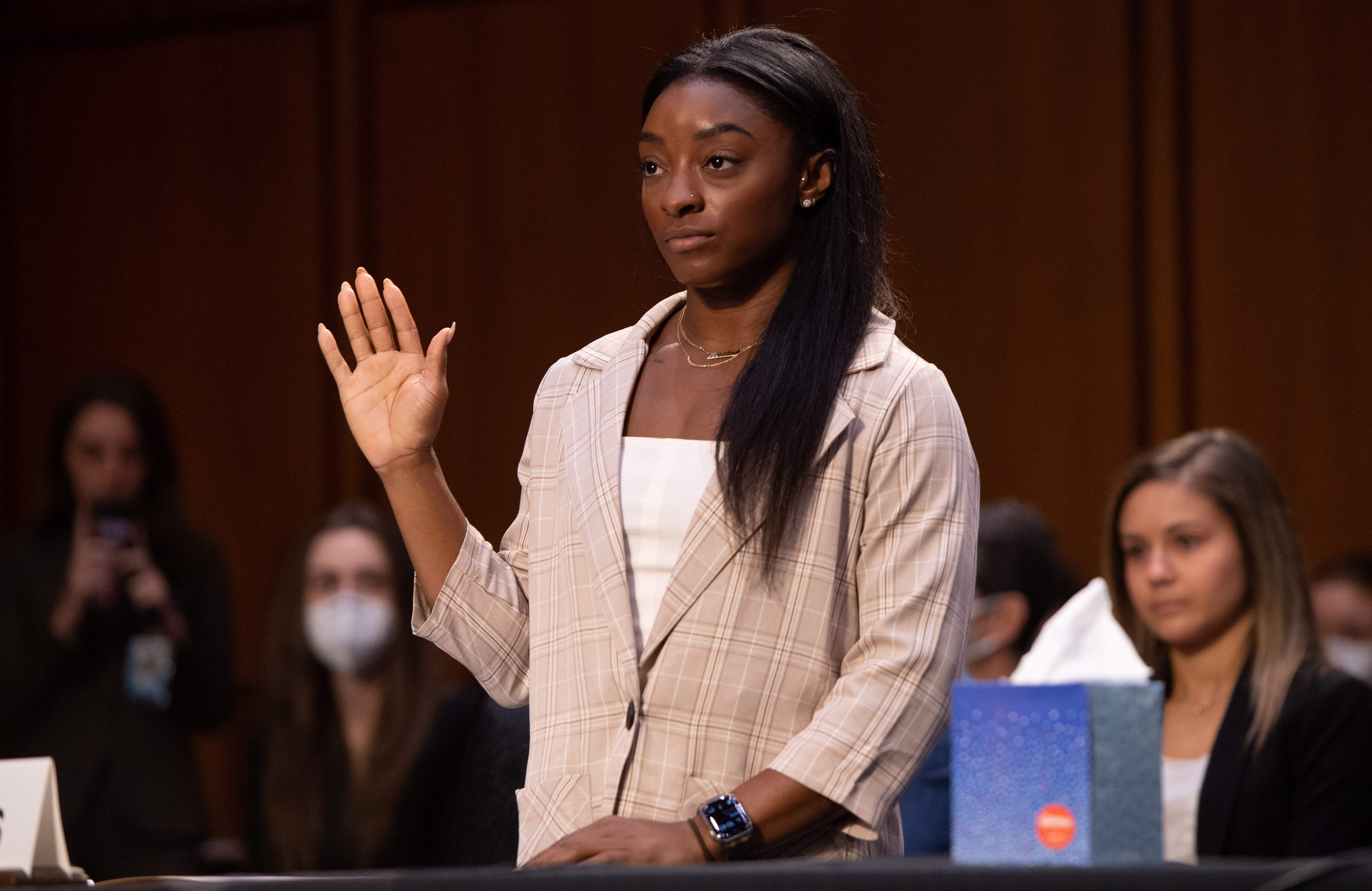 U.S. Olympic gymnast Simone Biles is sworn in to testify during a Senate Judiciary hearing about the Inspector General's report on the FBI handling of the Larry Nassar investigation of sexual abuse of Olympic gymnasts, on Capitol Hill, in Washington, D.C., U.S., September 15, 2021. Saul Loeb/Pool via REUTERS