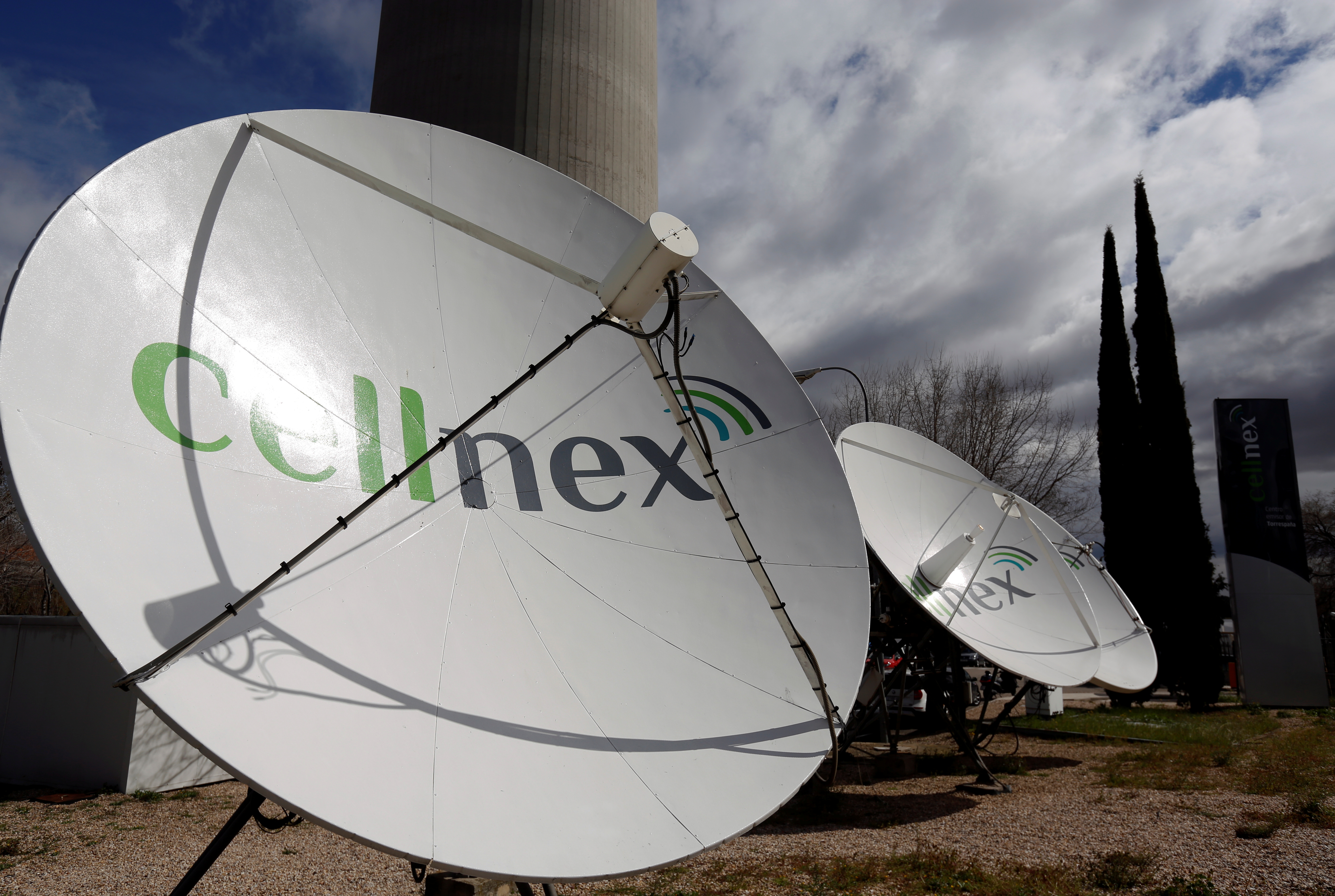 Telecom antennas of Spain's telecoms infrastructures firm Cellnex are seen under main telecom tower, known as
