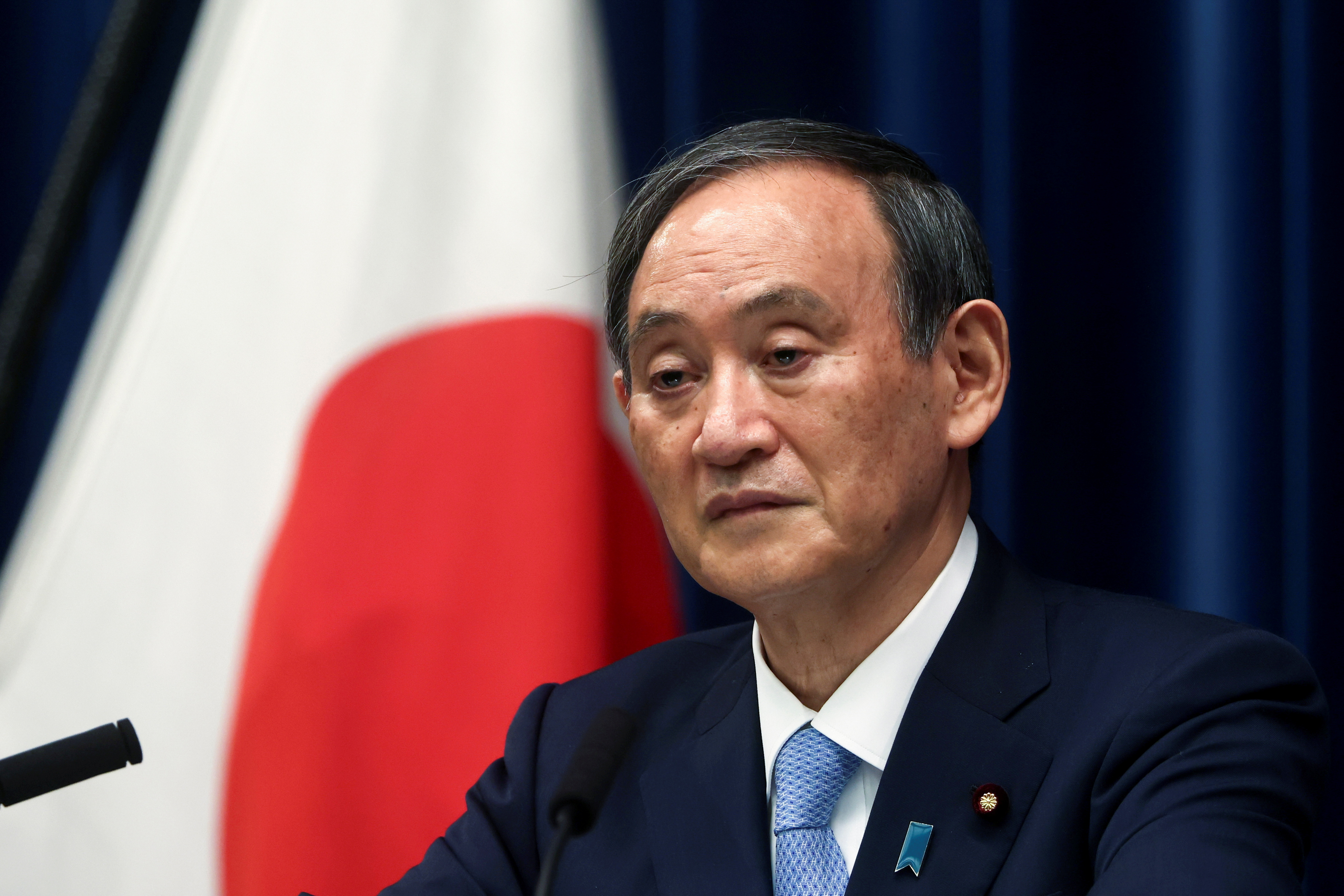 Japan's Prime Minister Yoshihide Suga speaks during a news conference after the government's decision to exted a state of emergency amid coronavirus disease (COVID-19) pandemic, at the prime minister's official residence in Tokyo, Japan May 28, 2021. Behrouz Mehri/Pool via REUTERS