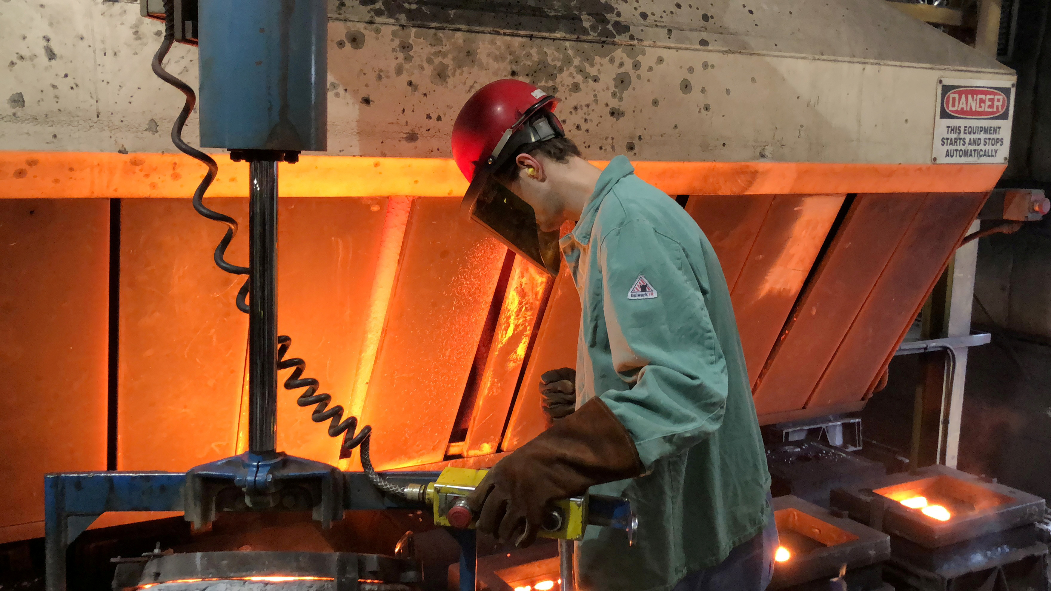 A worker pours hot metal at the Kirsh Foundry in Beaver Dam, Wisconsin, U.S., April 12, 2018. REUTERS/Timothy Aeppel
