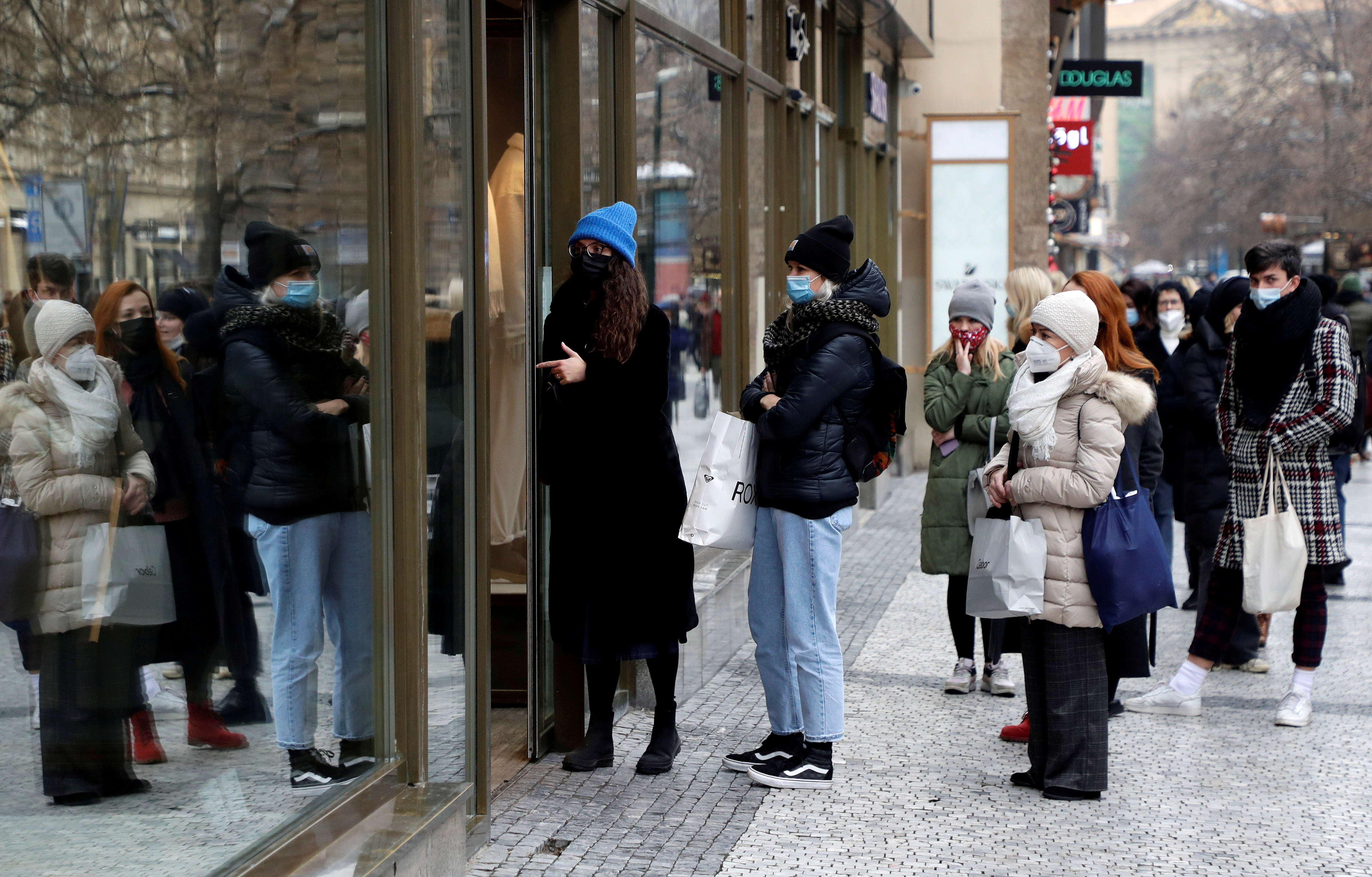 Customers queue in front of the re-opened shop, as restrictions ease following the coronavirus disease (COVID-19) outbreak in Prague, Czech Republic, December 3, 2020.    REUTERS/David W Cerny