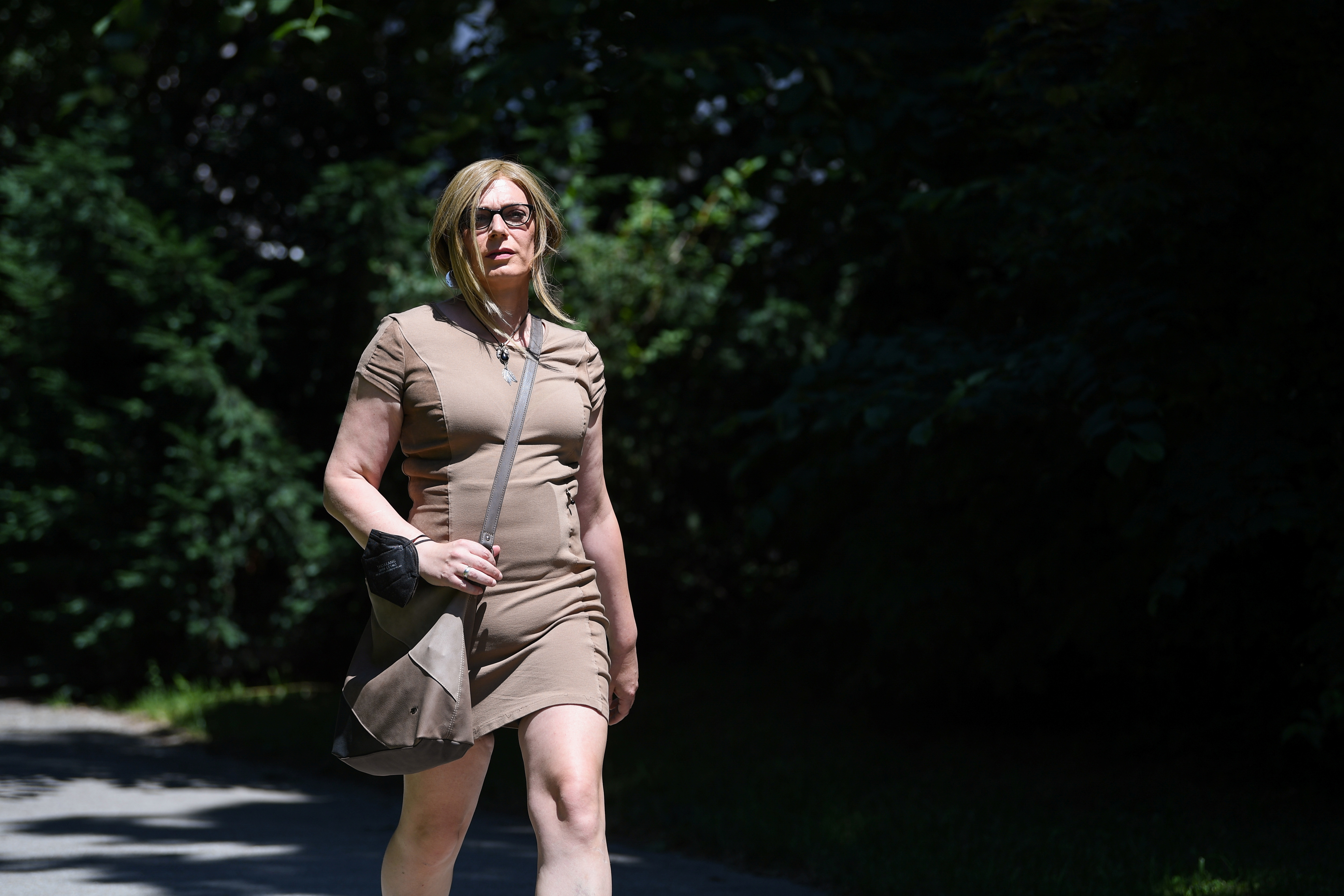 Tessa Ganserer, member of the German Green Party and transgender candidate for the German Bundestag elections walks from her office to the Parliament during a Reuters TV interview in Munich, Germany, July 6, 2021. REUTERS/Andreas Gebert