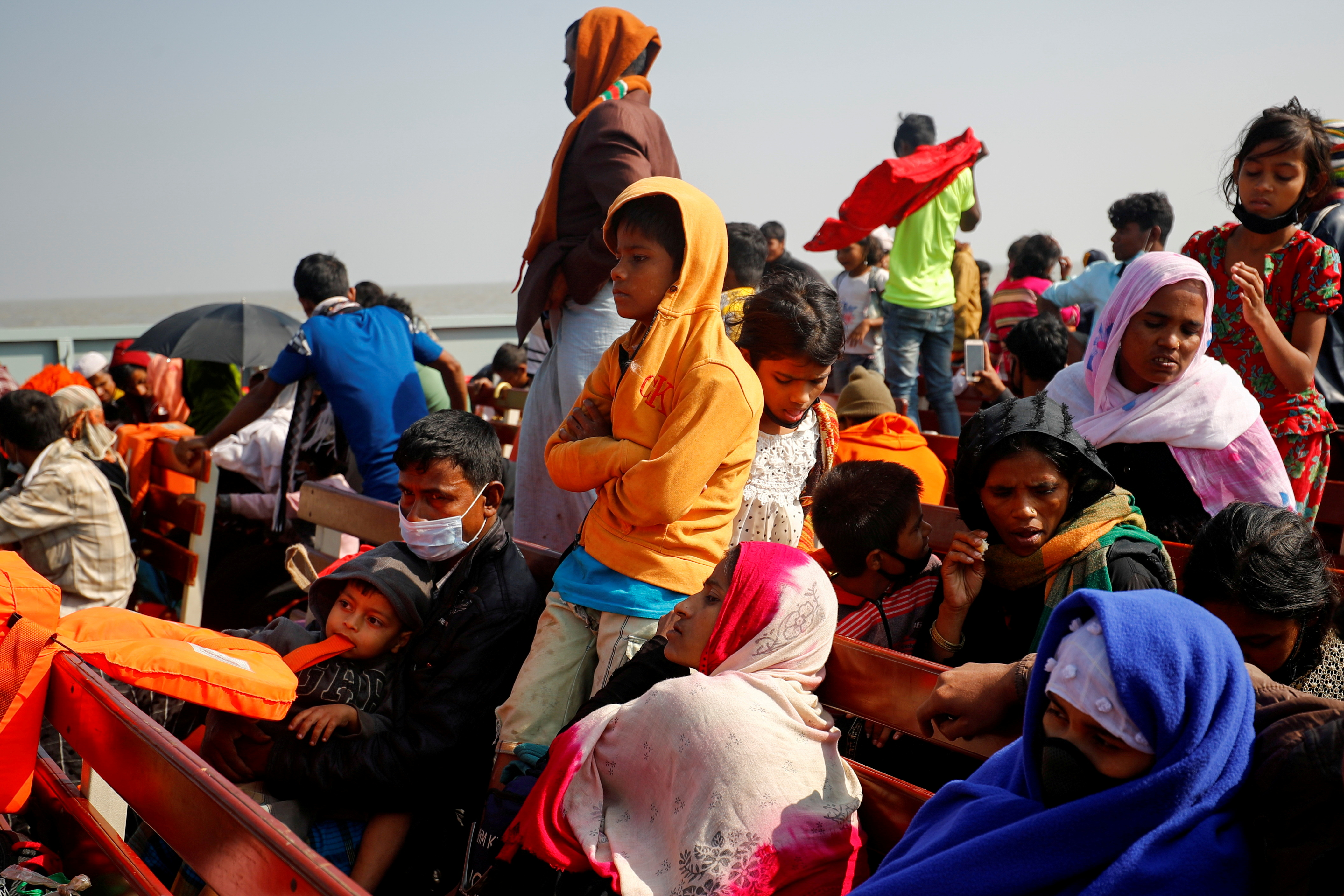 Rohingya refugees sit on wooden benches of a navy vessel on their way to the Bhasan Char island in Noakhali district, Bangladesh, December 29, 2020. REUTERS/Mohammad Ponir Hossain/File Photo/File Photo