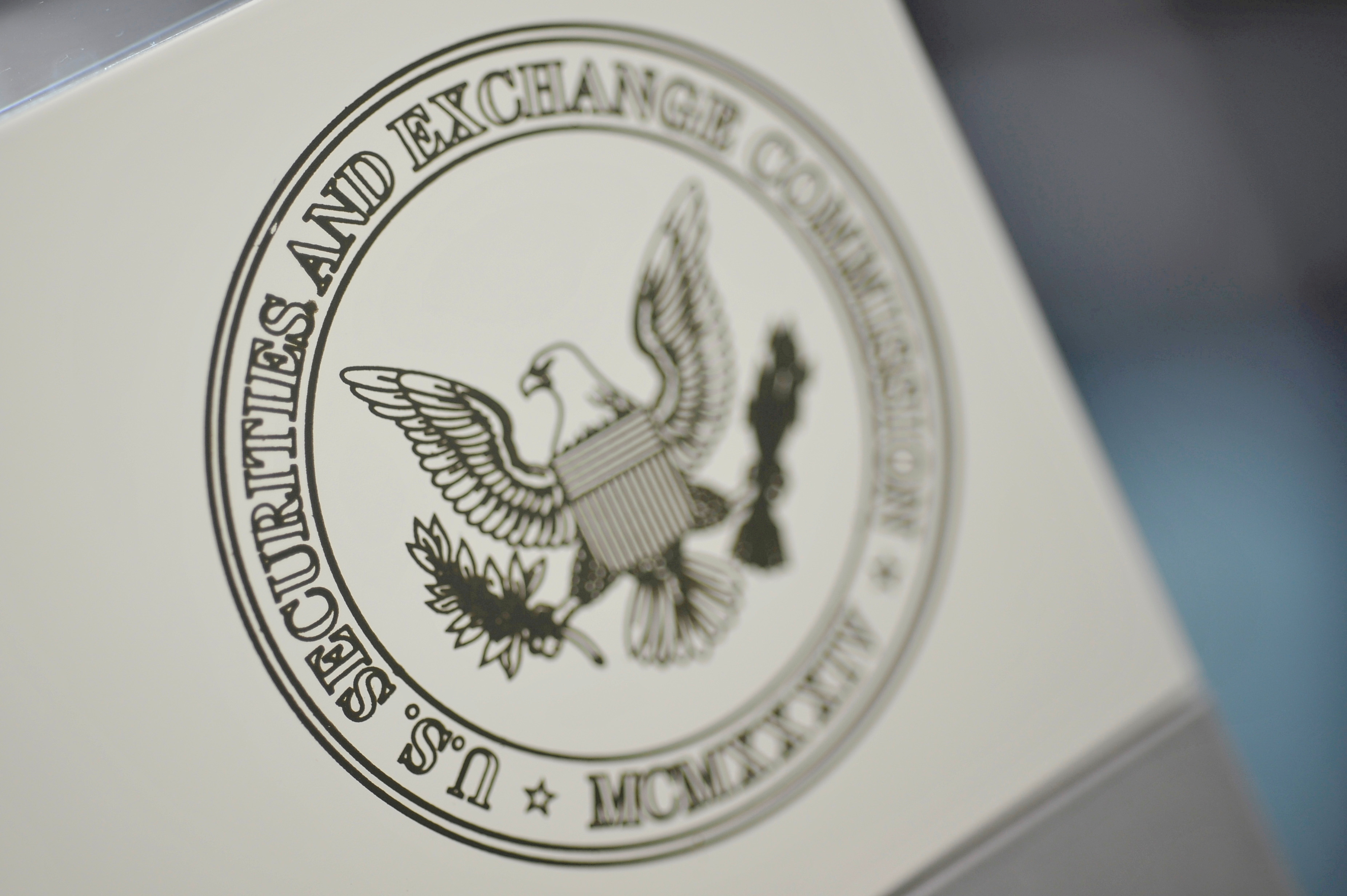 The U.S. Securities and Exchange Commission logo adorns an office door at the SEC headquarters in Washington, June 24, 2011. REUTERS/Jonathan Ernst//File Photo