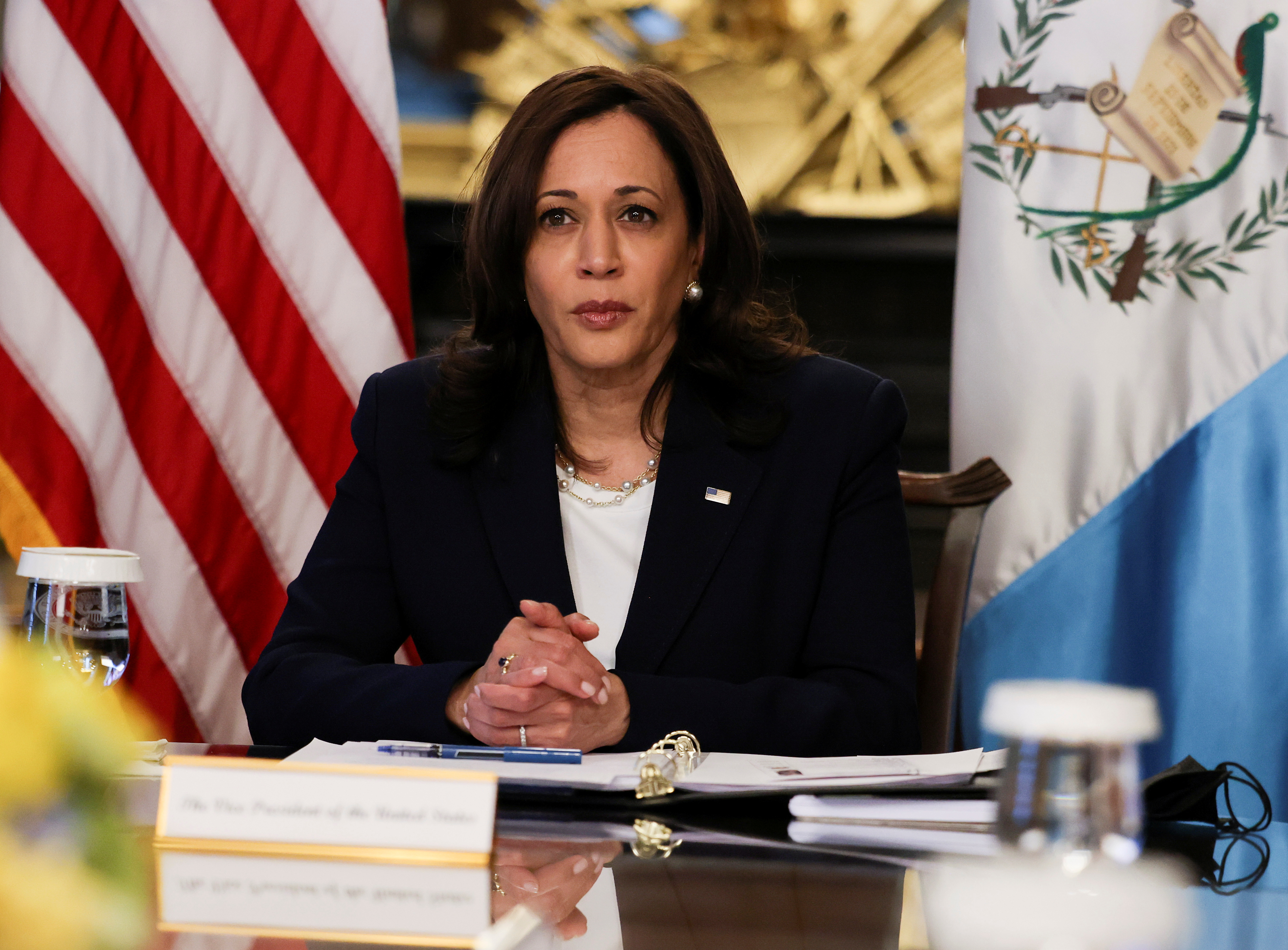 U.S. Vice President Kamala Harris holds a videoconference with Guatemala's President Alejandro Giammattei to discuss solutions to an increase in migration as she looks for ways to defuse a migrant crisis at the U.S. border with Mexico, in the Eisenhower Executive Office Building at the White House in Washington, U.S., April 26, 2021. REUTERS/Evelyn Hockstein