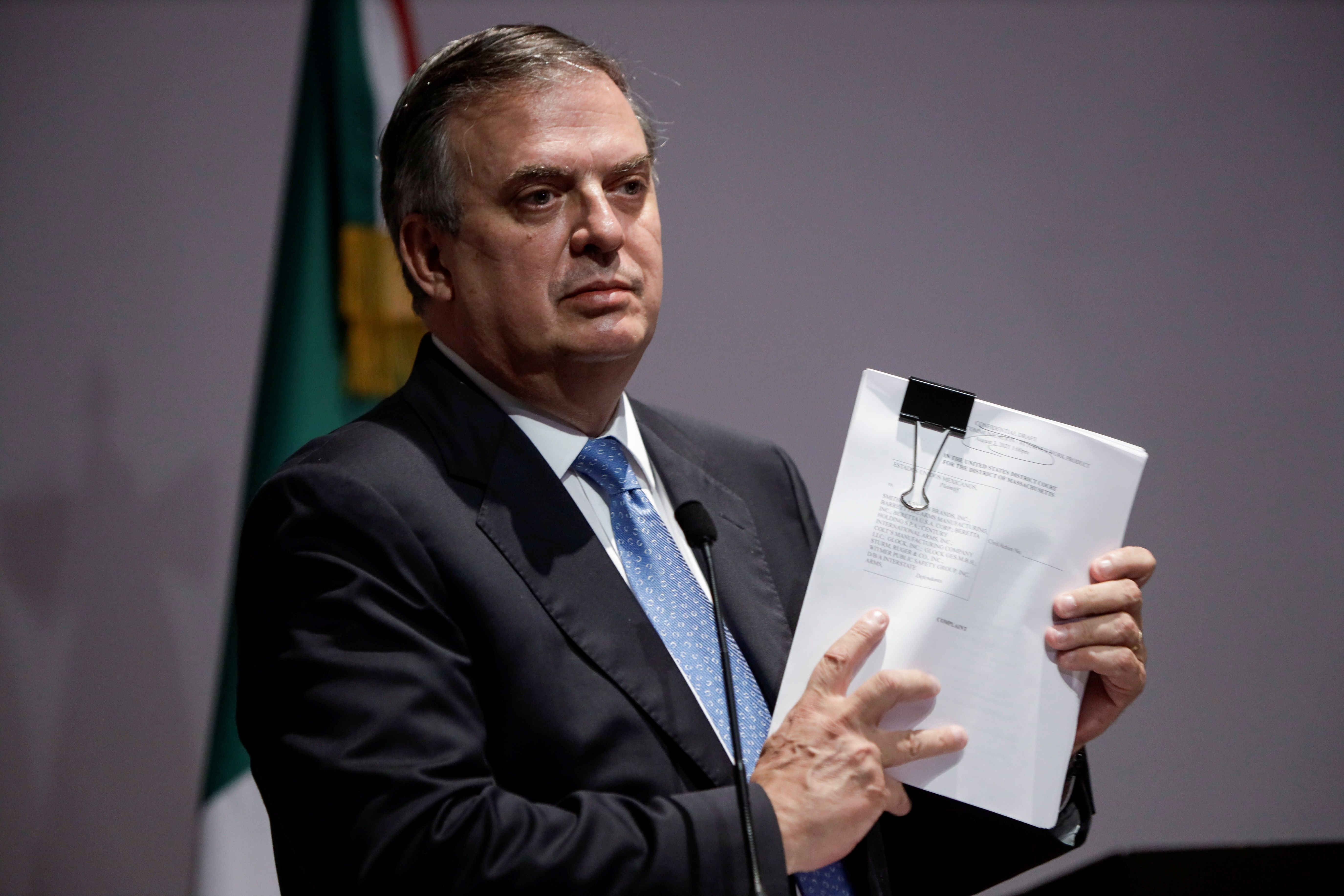 Mexican Foreign Minister Marcelo Ebrard holds documents during a news conference to announce that Mexico sued several gun makers in a U.S. federal court, accusing them of negligent business practices that generated illegal arms trafficking which led to deaths in Mexico, in Mexico City, Mexico August 4, 2021. REUTERS/Luis Cortes