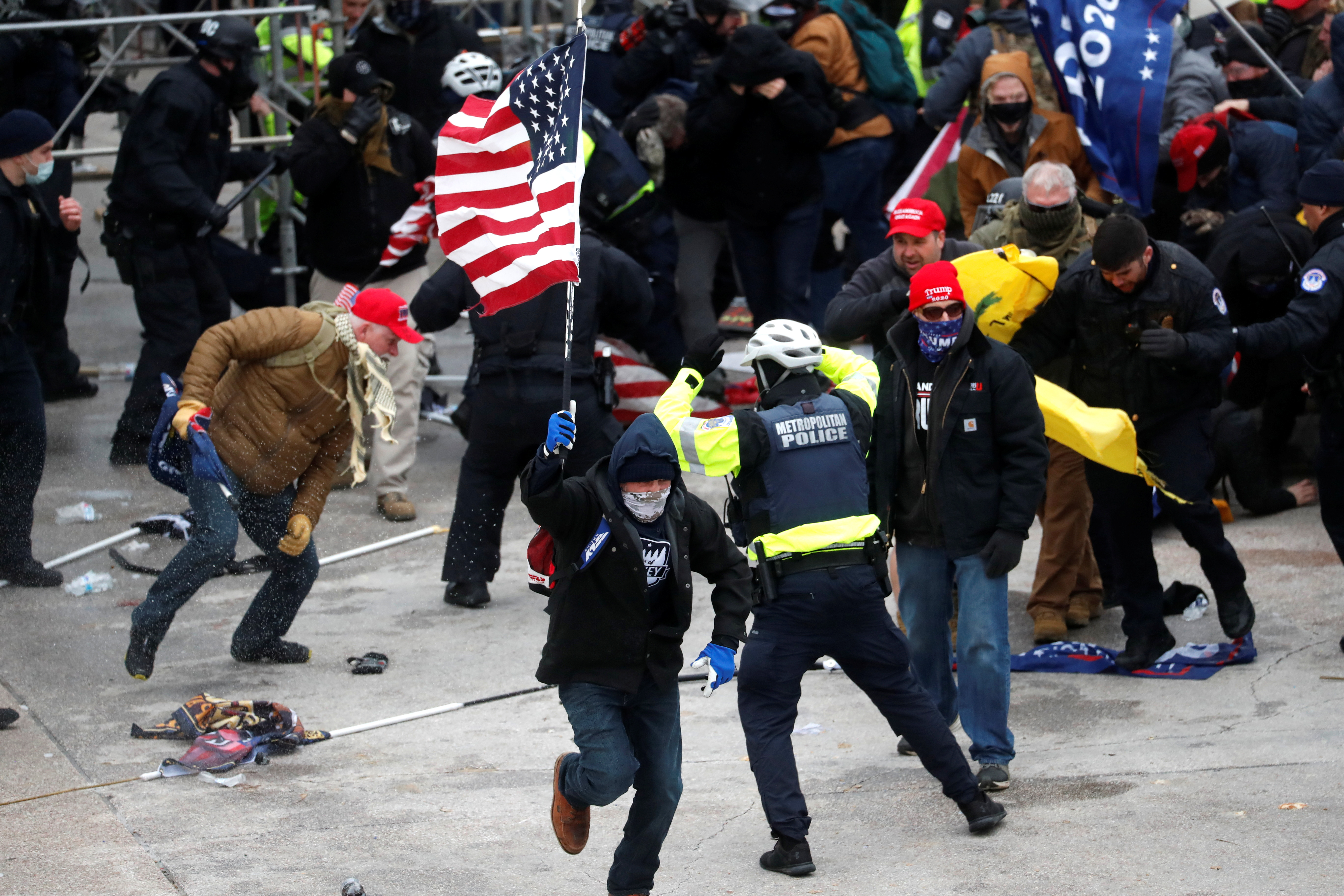 Pro-Trump protesters clash with Capitol police during a rally to contest the certification of the 2020 U.S. presidential election results by the U.S. Congress, at the U.S. Capitol Building in Washington, U.S, January 6, 2021. REUTERS/Shannon Stapleton