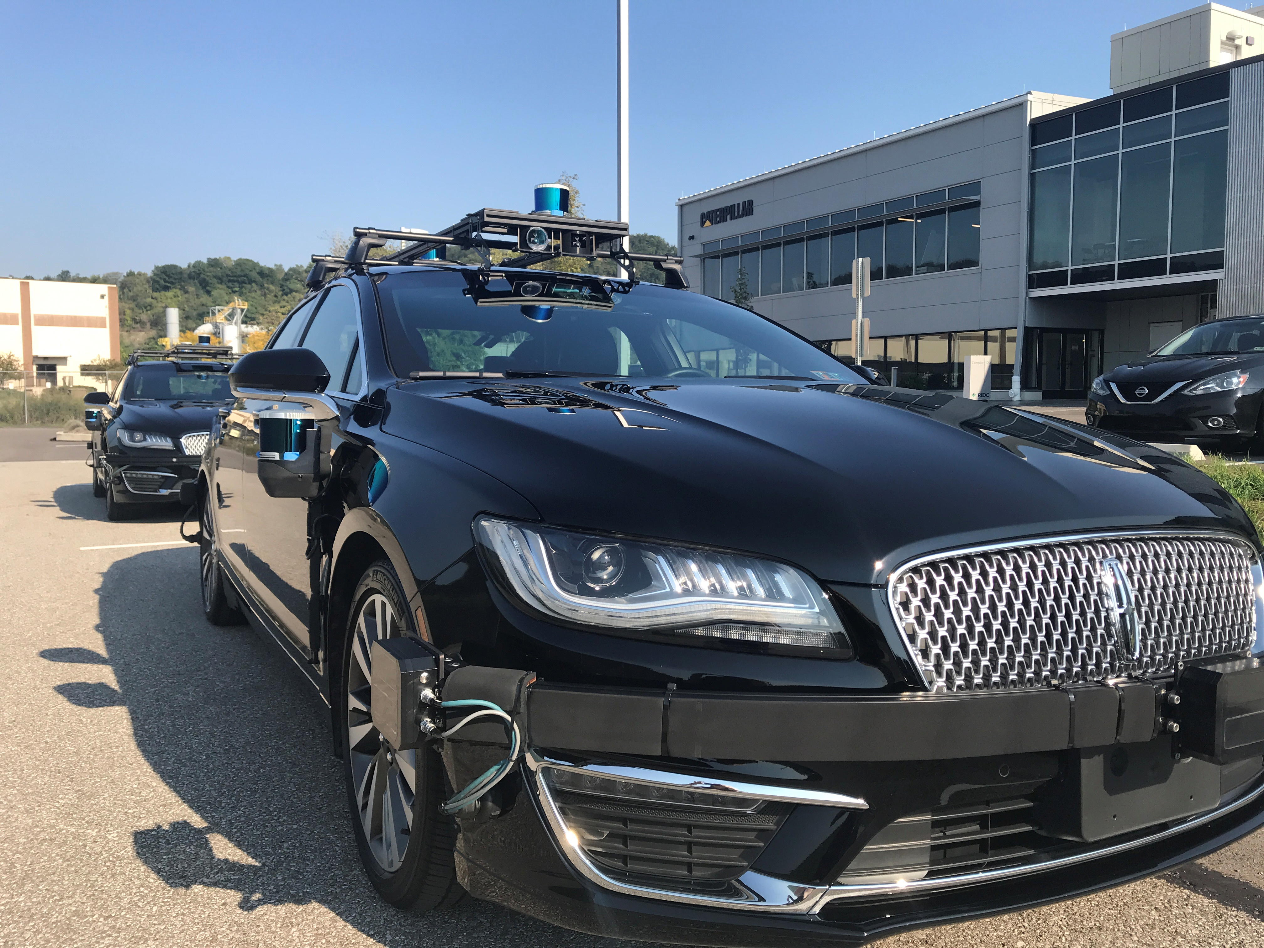 An Aurora self-driving Lincoln MKZ car is seen outside the company's office in the Lawrenceville neighborhood in Pittsburgh, Pennsylvania, U.S., September 21, 2018.   REUTERS/Heather Somerville