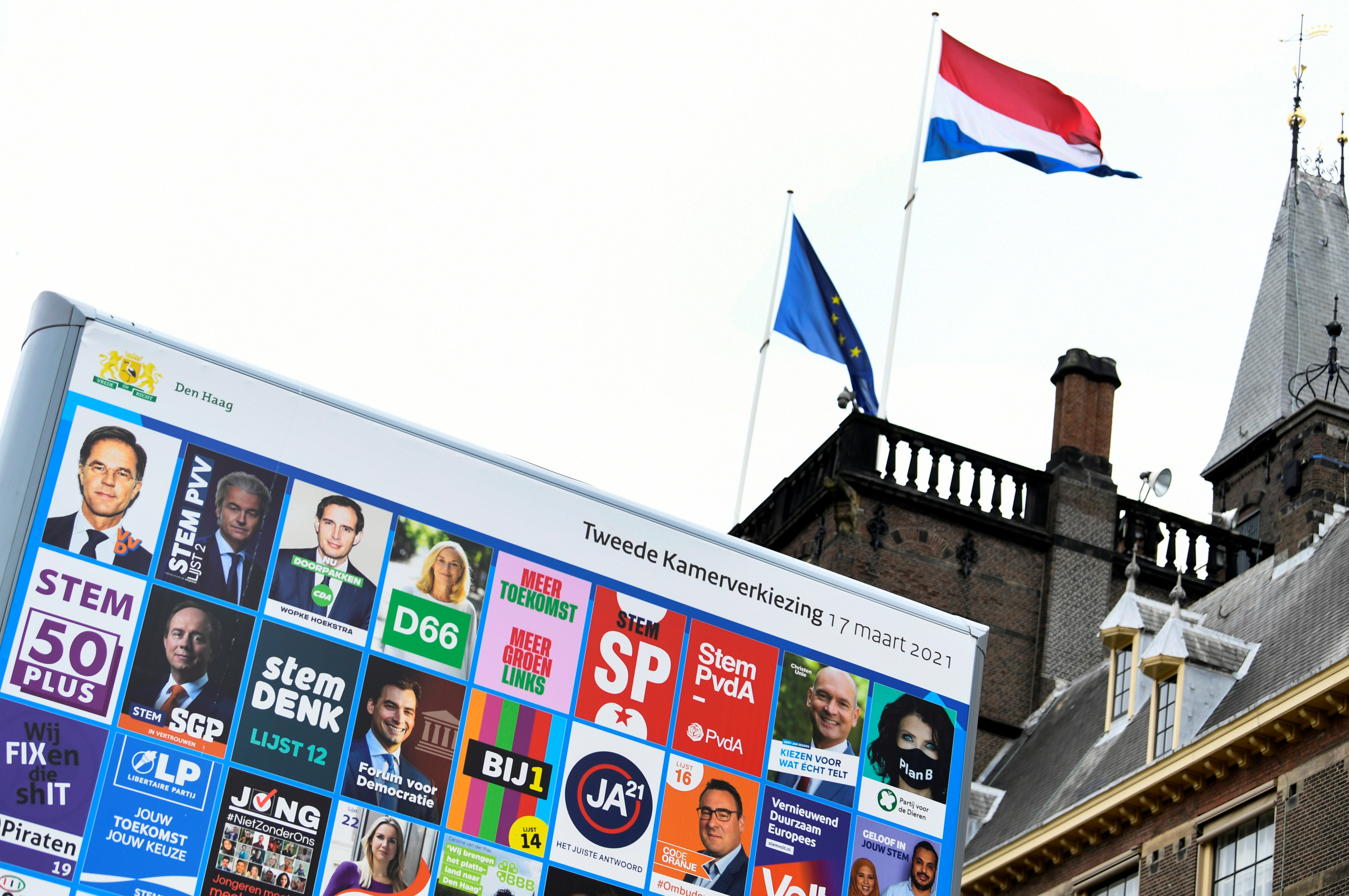 An election sign is seen at the parliament building in The Hague, Netherlands March 9, 2021. Picture taken March 9, 2021. REUTERS/Piroschka van de Wouw