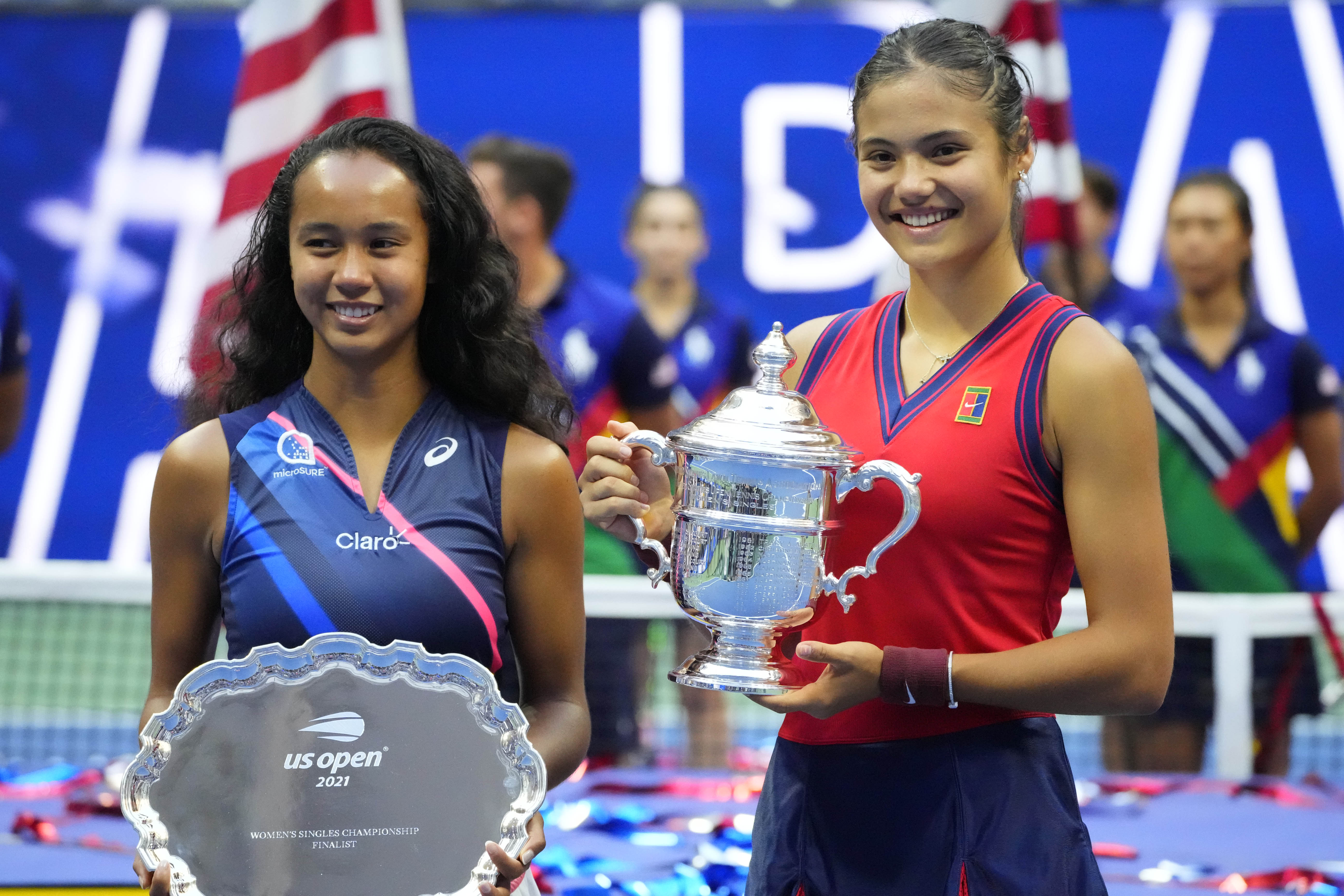 Sep 11, 2021; Flushing, NY, USA; (L-R) Leylah Fernandez of Canada and Emma Raducanu of Great Britain celebrate with the finalist and championship trophy (respectively) after their match in the women's singles final on day thirteen of the 2021 U.S. Open tennis tournament at USTA Billie Jean King National Tennis Center. Mandatory Credit: Robert Deutsch-USA TODAY Sports/File photo