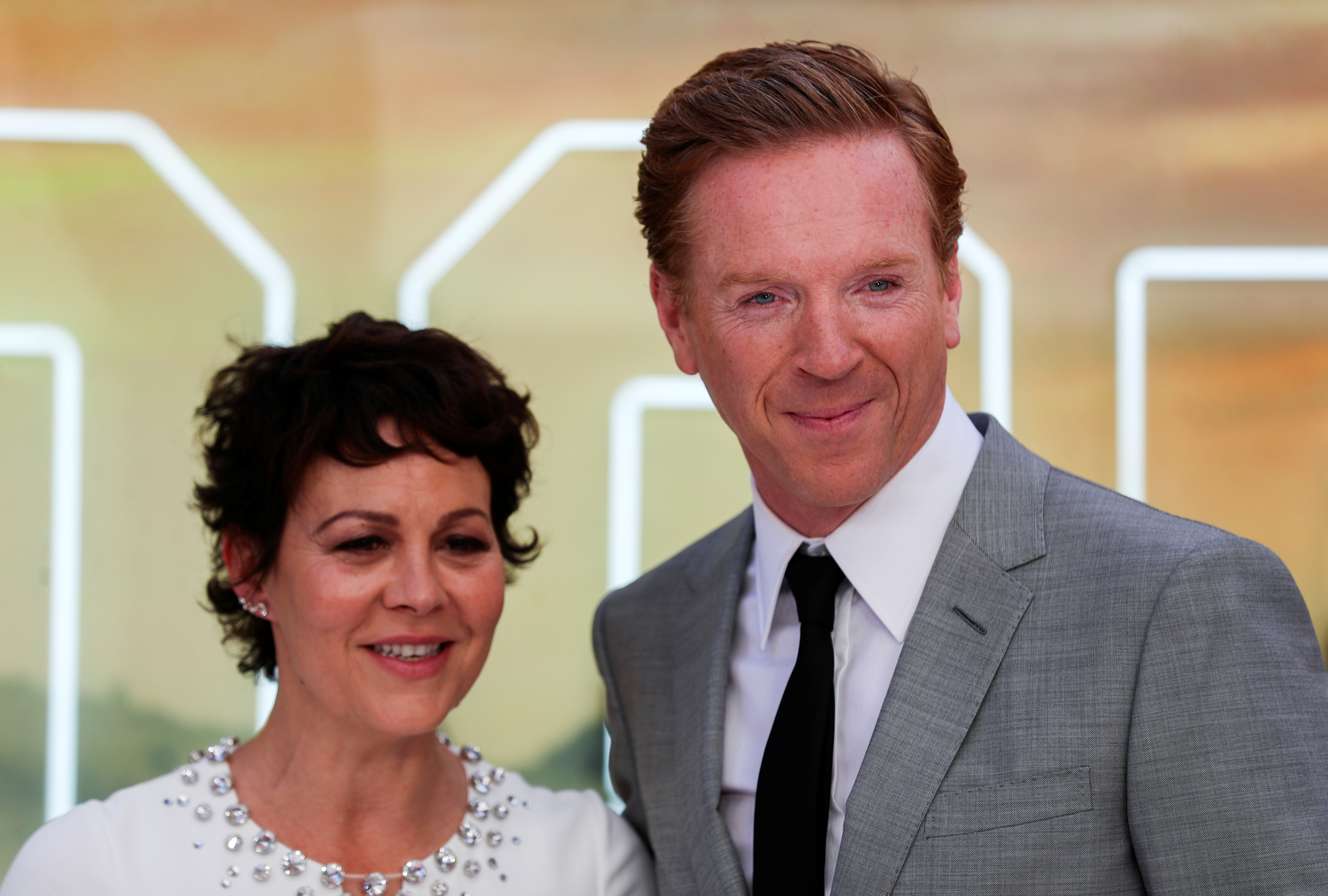 Actor Damian Lewis and his wife Helen McCrory pose as they arrive for the London premiere of