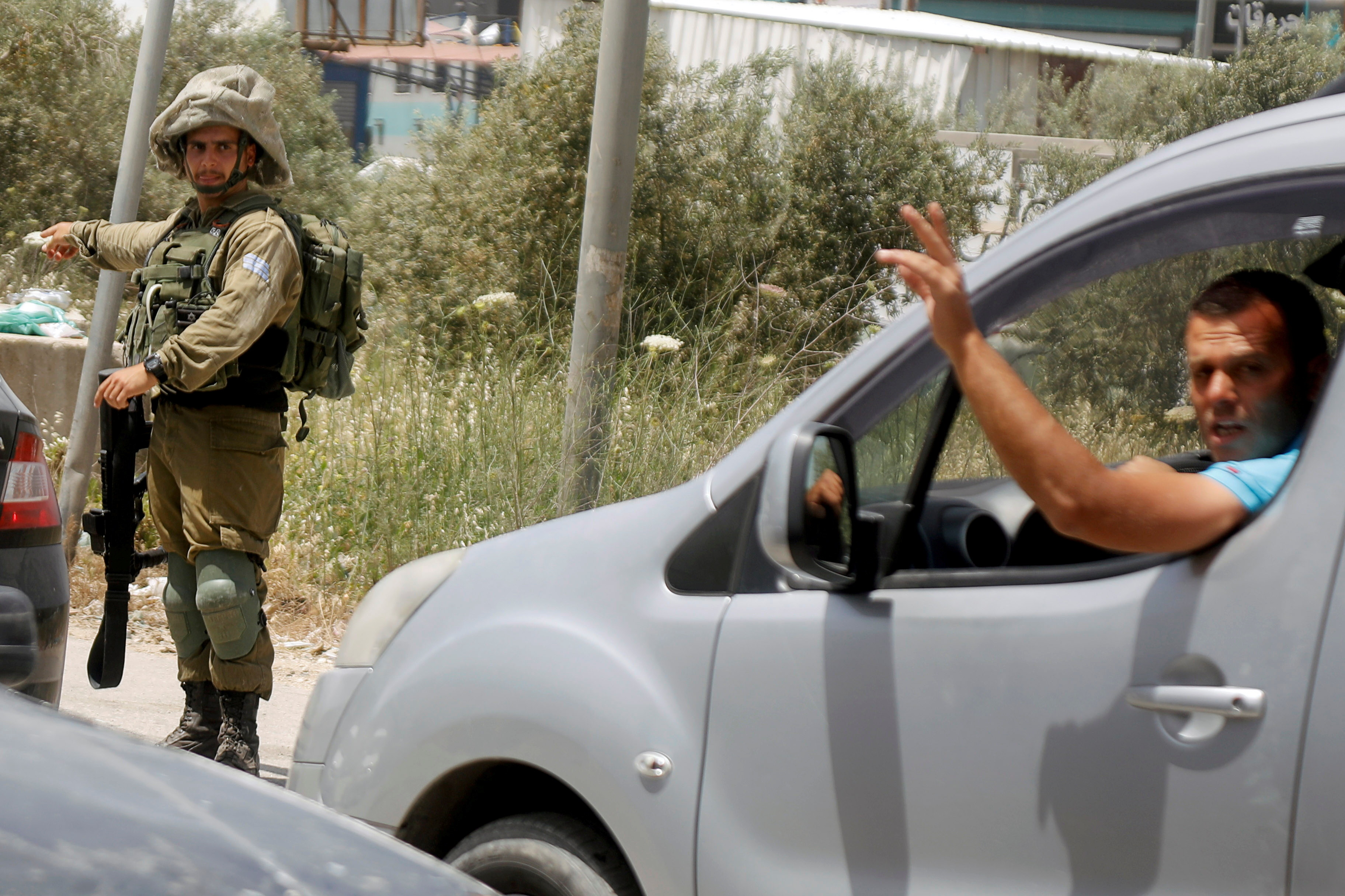An Israeli soldier gestures during a search operation in the Palestinian town of Beita near Nablus in the Israeli-occupied West Bank May 5, 2021. REUTERS/Raneen Sawafta
