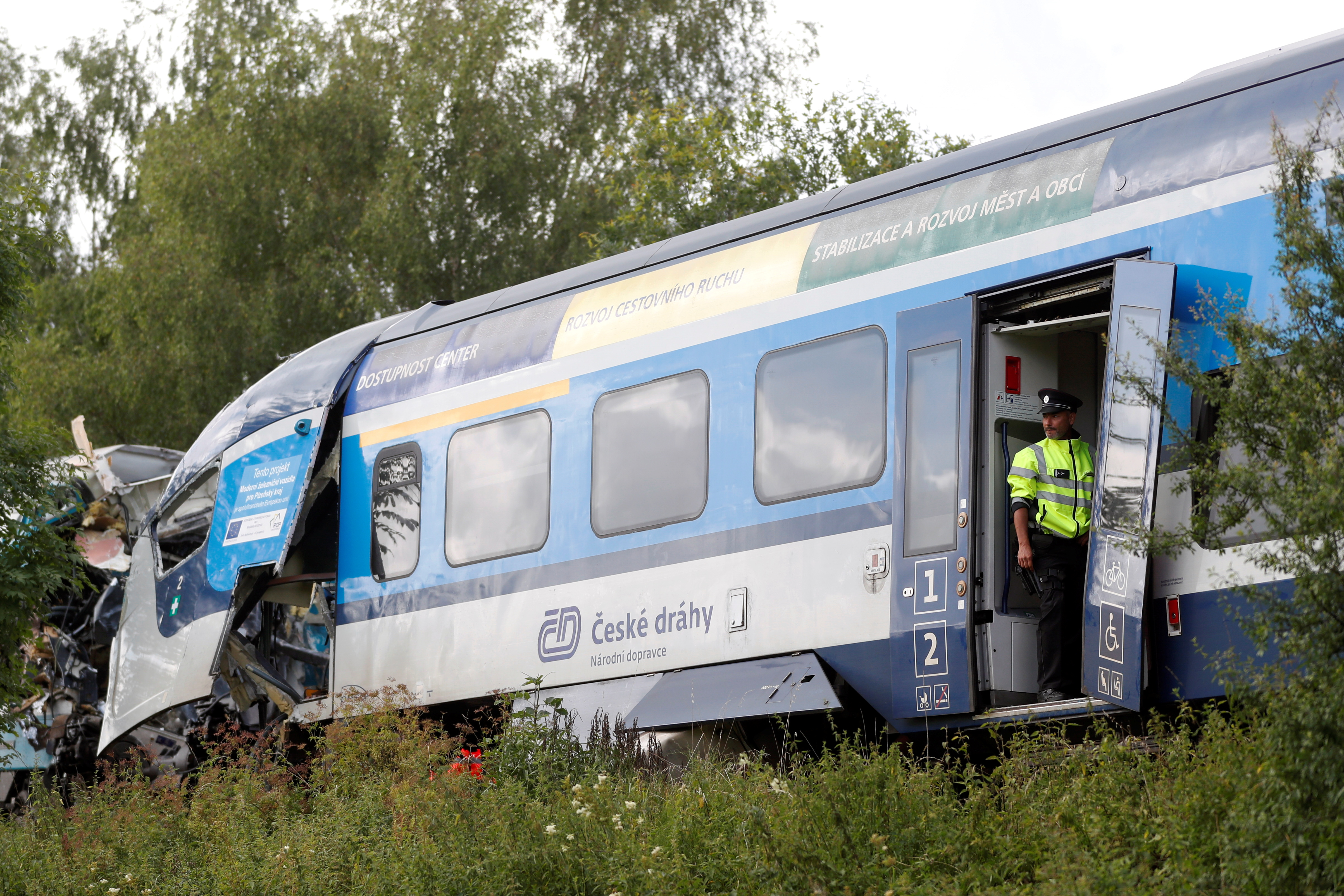 A police officer looks on from a carriage on a site of a train crash near the town of Domazlice, Czech Republic, August 4, 2021. REUTERS/David W Cerny
