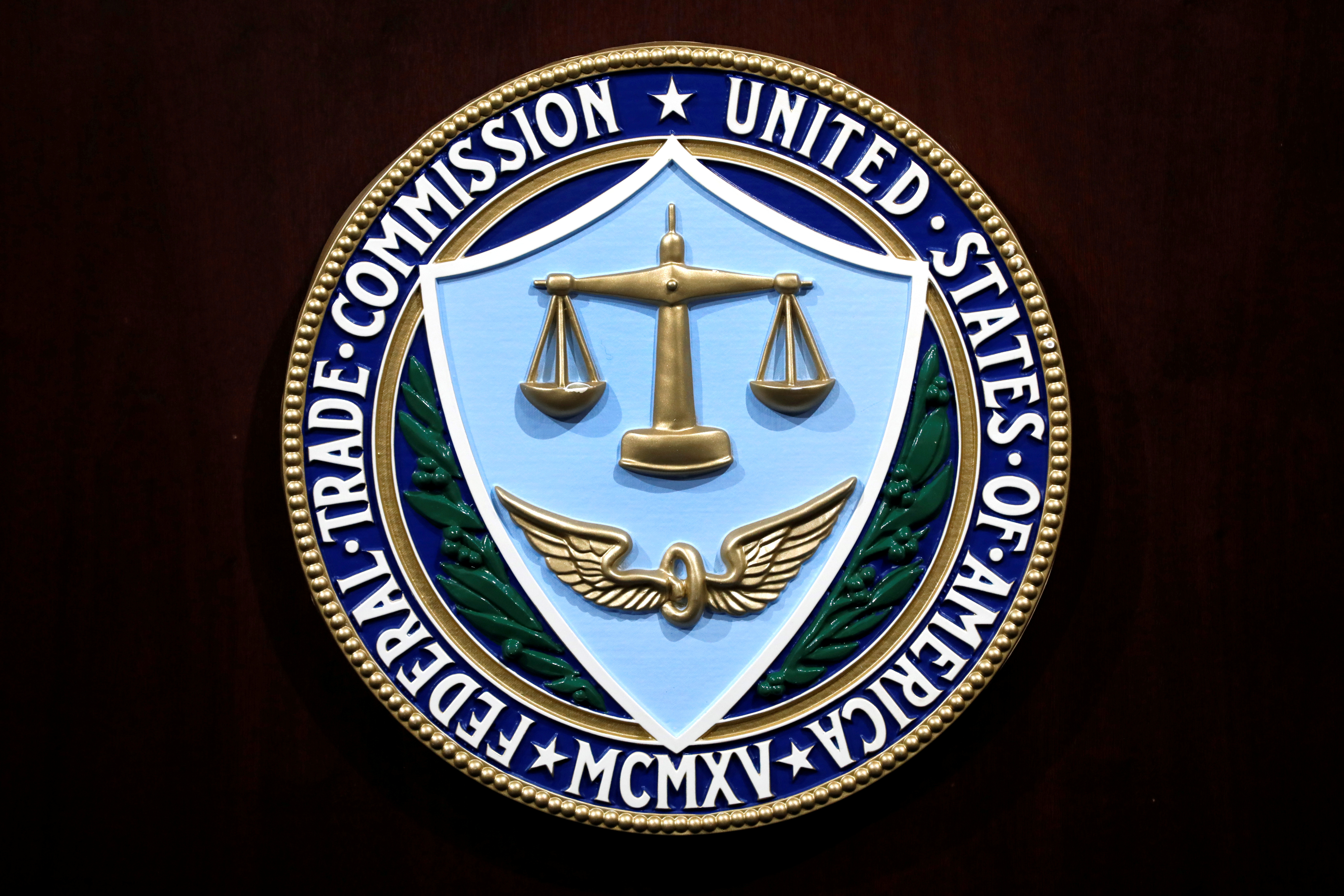 The U.S. Federal Trade Commission seal is seen at a news conference at FTC Headquarters in Washington, U.S., July 24, 2019. REUTERS/Yuri Gripas/File Photo