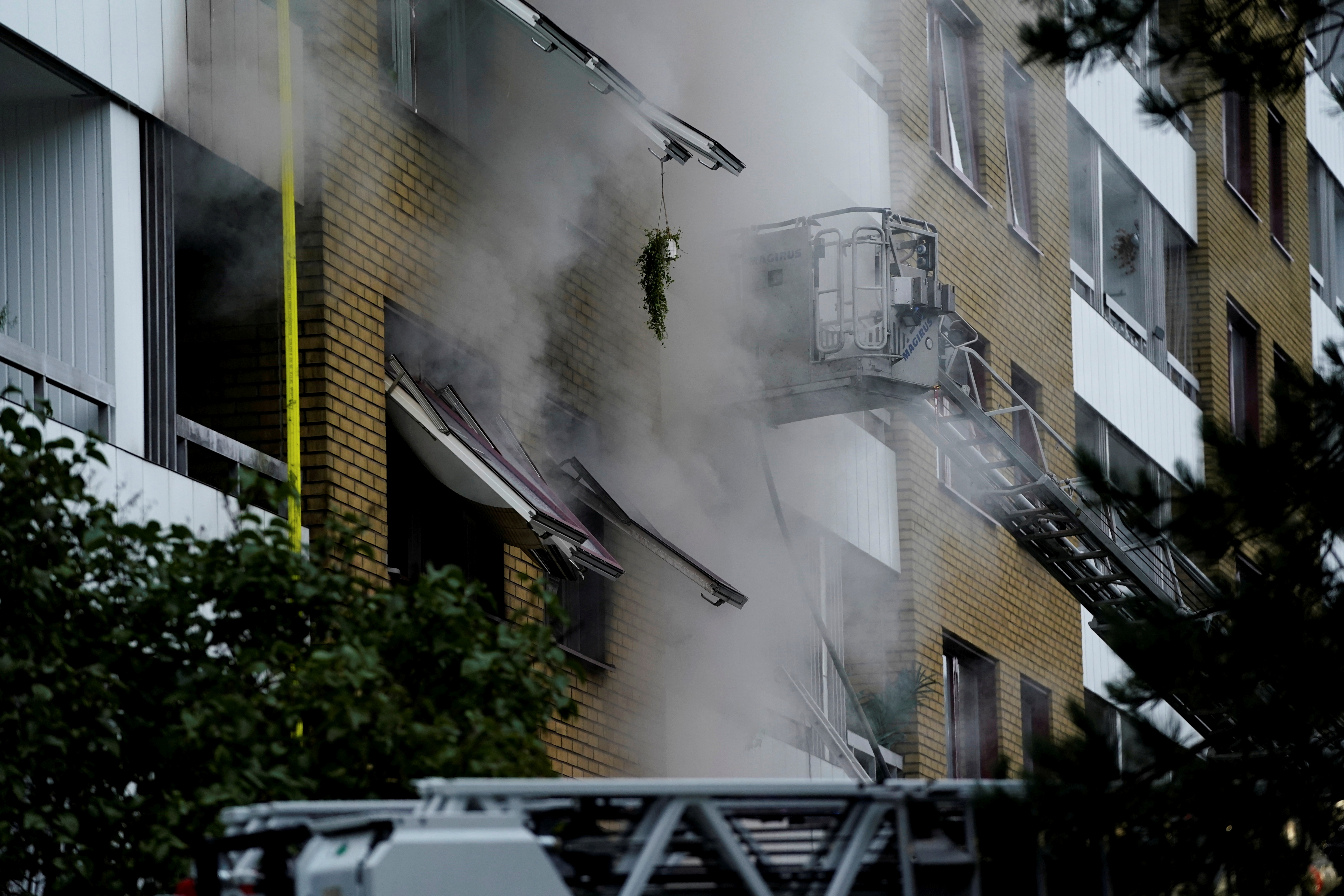 Smoke comes out of windows after an explosion hit an apartment building in Annedal, central Gothenburg, Sweden September 28, 2021. Larsson Rosvall / TT News Agency/via REUTERS