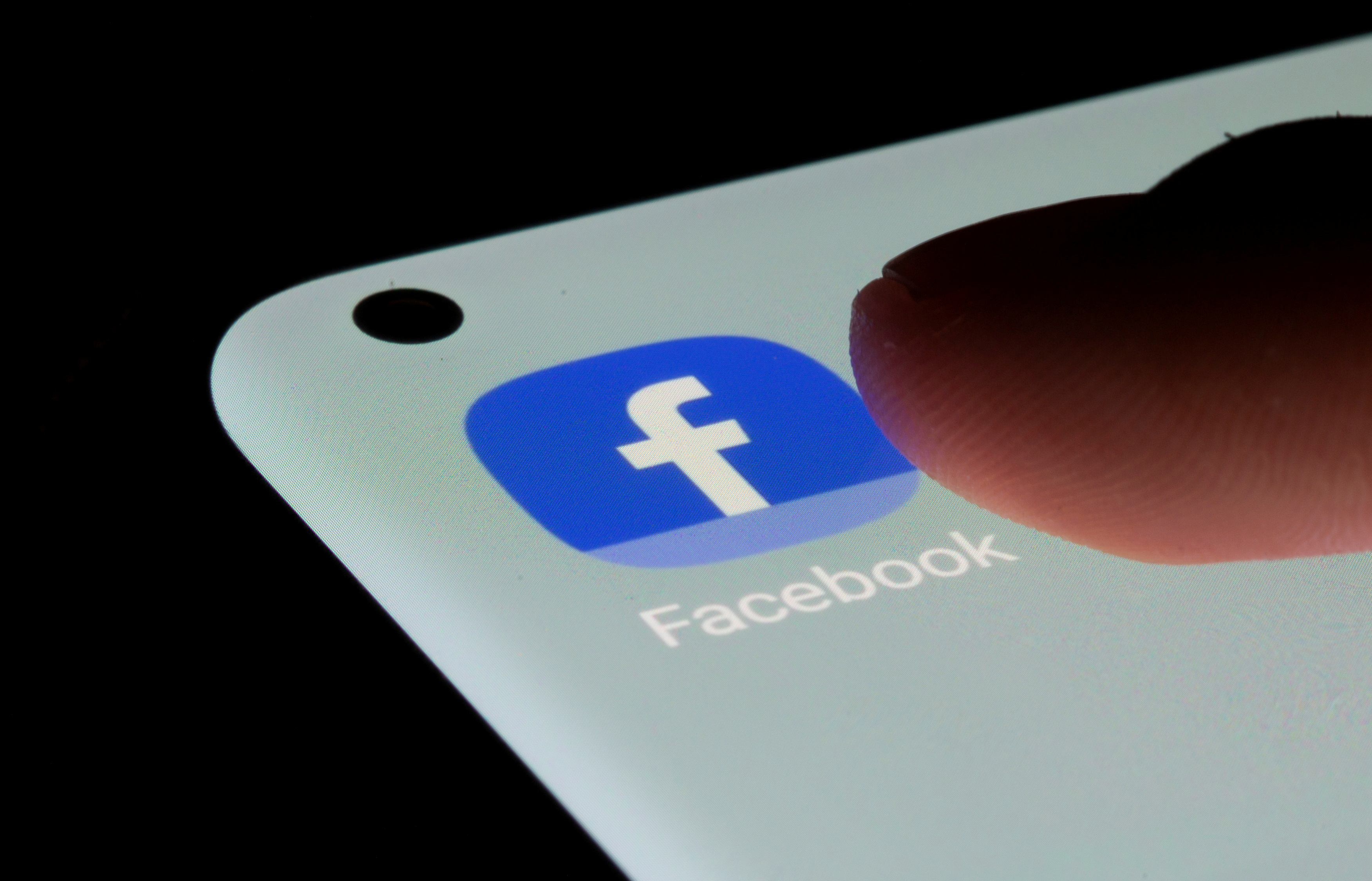Facebook app is seen on a smartphone in this illustration taken, July 13, 2021. REUTERS/Dado Ruvic/Illustration/File Photo