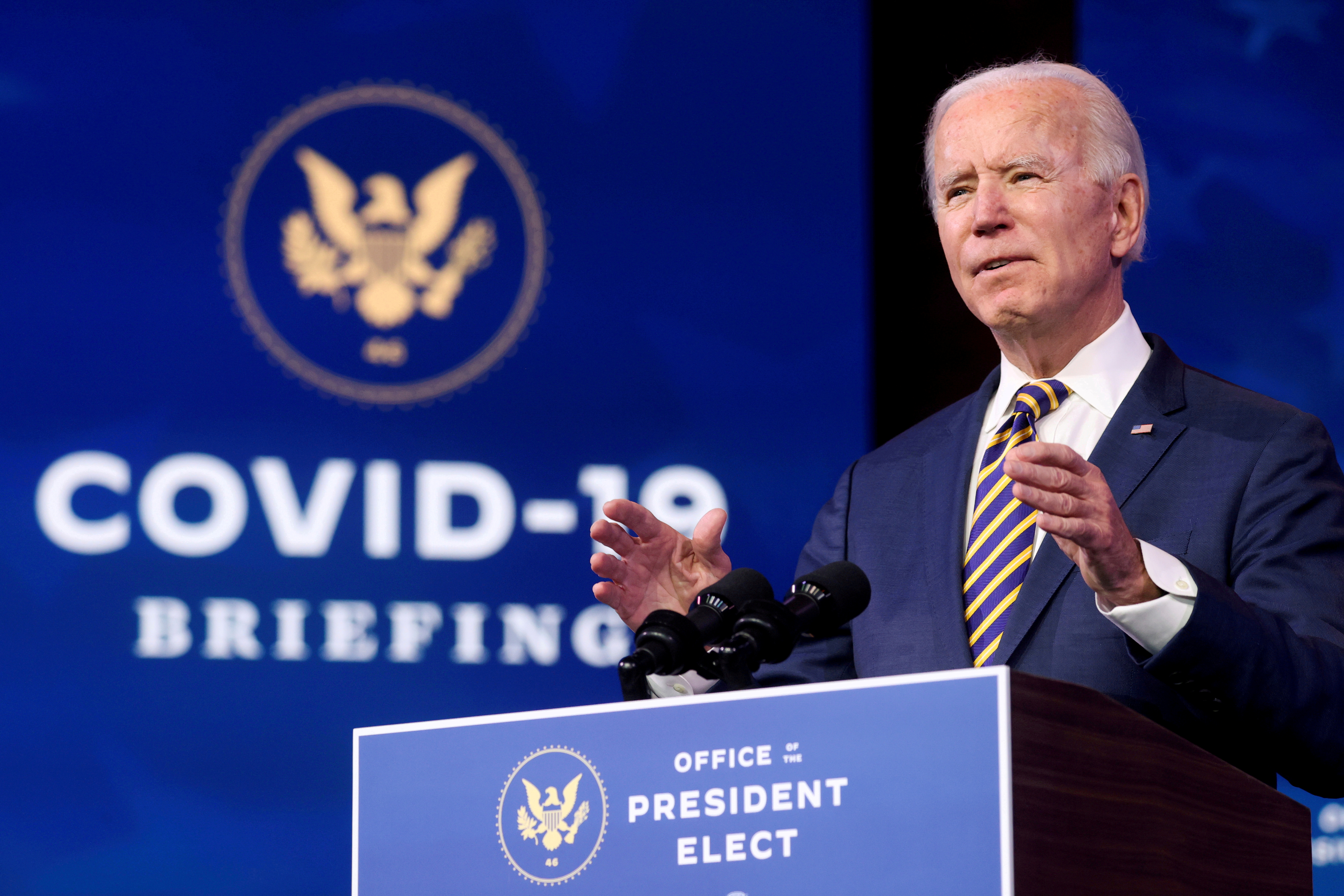 U.S. President-elect Joe Biden delivers remarks on the U.S. response to the coronavirus disease (COVID-19) outbreak, at his transition headquarters in Wilmington, Delaware, U.S., December 29, 2020. REUTERS/Jonathan Ernst/File Photo