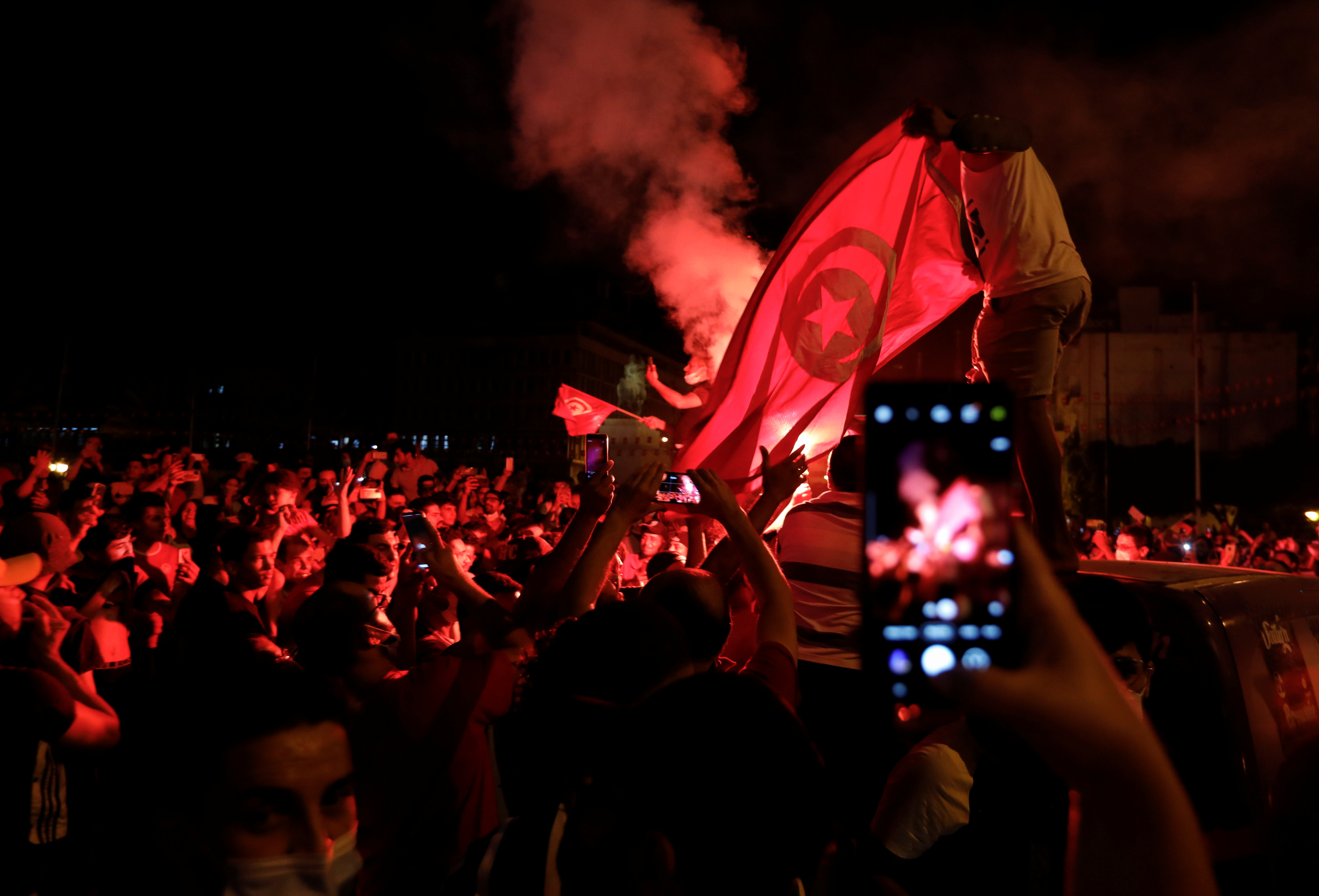 Supporters of Tunisia's President Kais Saied gather on the streets as they celebrate after he dismissed the government and froze parliament, in Tunis, Tunisia July 25, 2021. REUTERS/Zoubeir Souissi