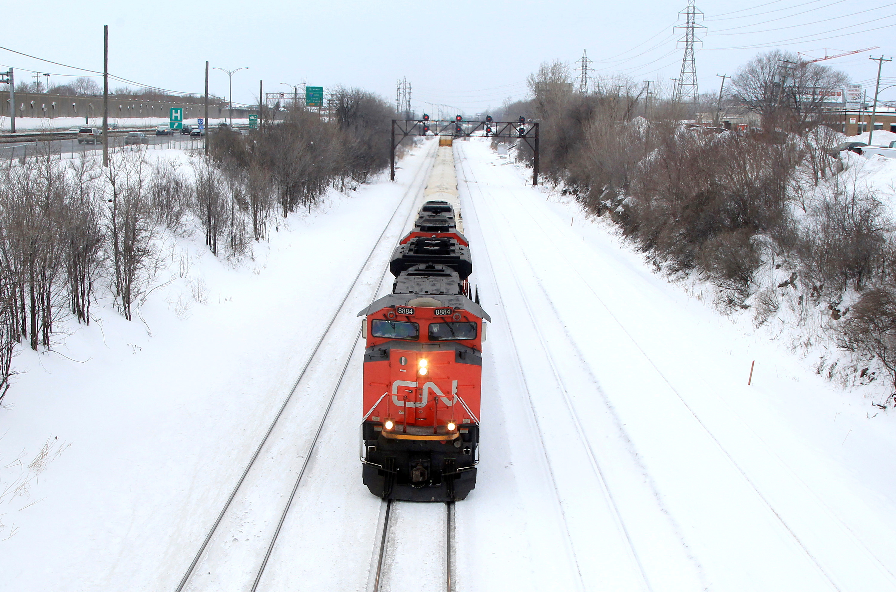 A Canadian National Railway train travels eastward on a track in Montreal, February 22, 2015. REUTERS/Christinne Muschi/File Photo