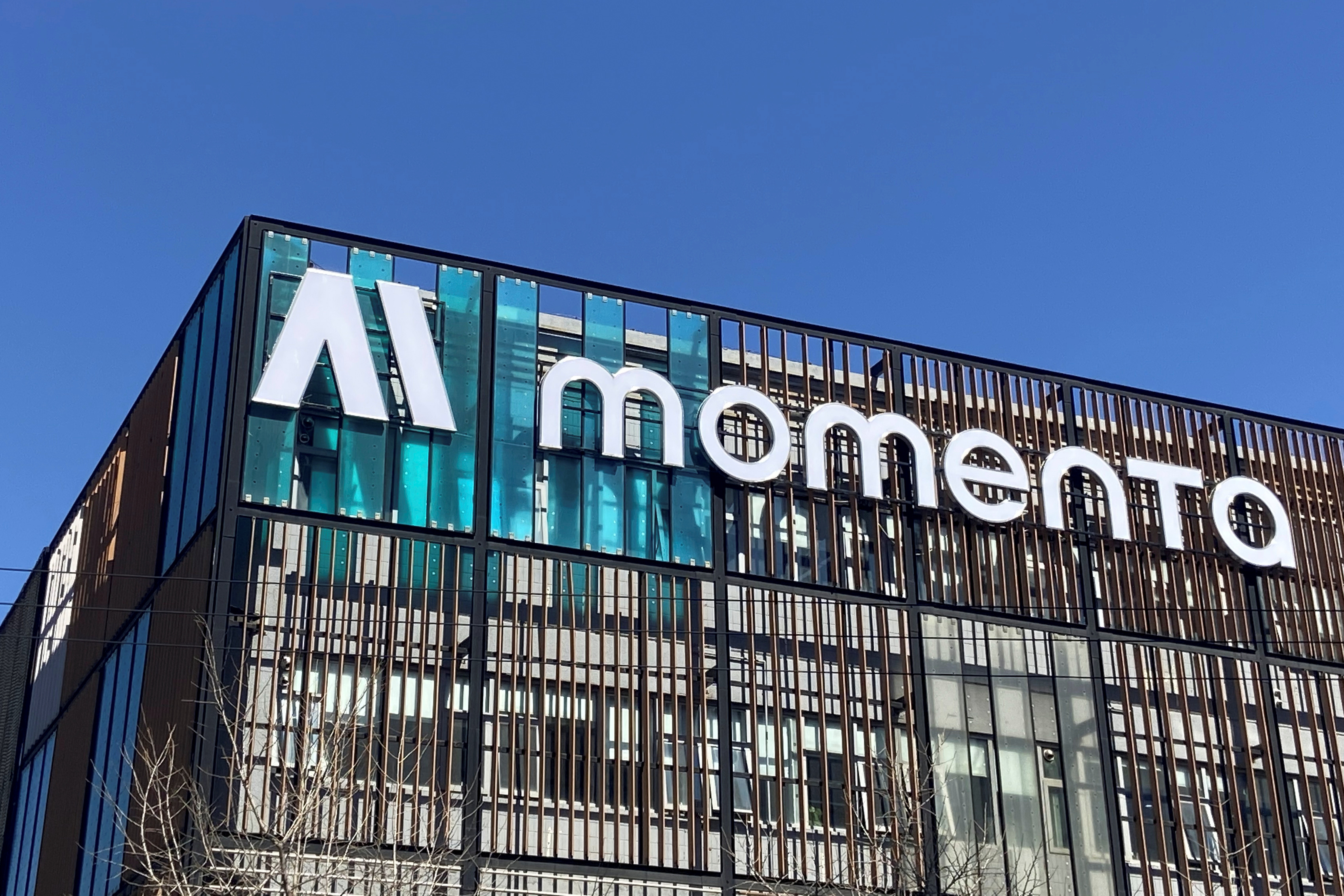 The company logo of Chinese autonomous driving startup Momenta is seen on the facade of its office building in Beijing, China March 13, 2020. Picture taken March 13, 2020. REUTERS/Yilei Sun